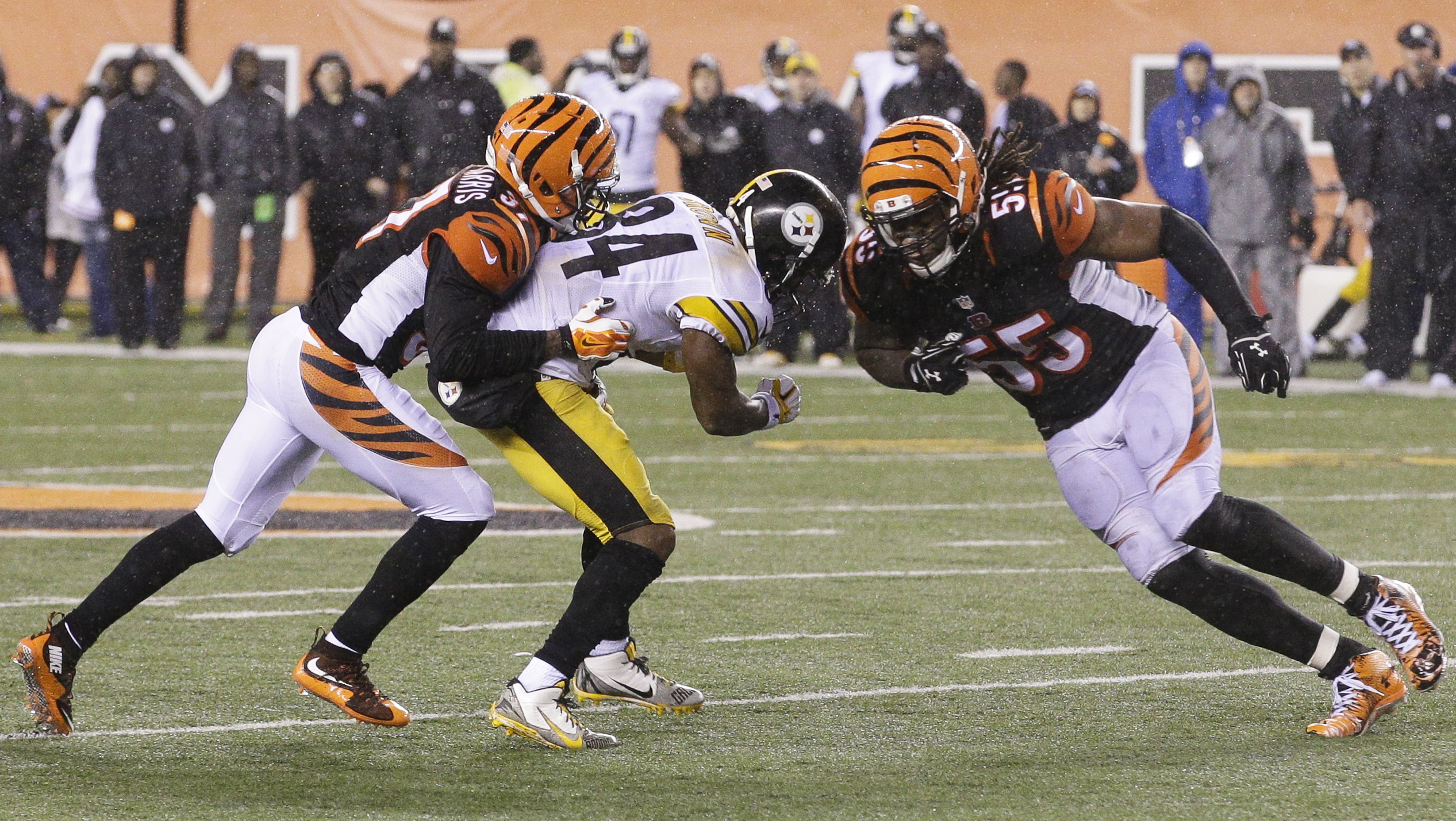 FILE - In this Jan. 10, 2016, file photo, Cincinnati Bengals' Vontaze Burfict (55), right, runs into Pittsburgh Steelers' Antonio Brown (84) during the second half of an NFL wild-card playoff football game in Cincinnati. Burfict was called for a penalty o