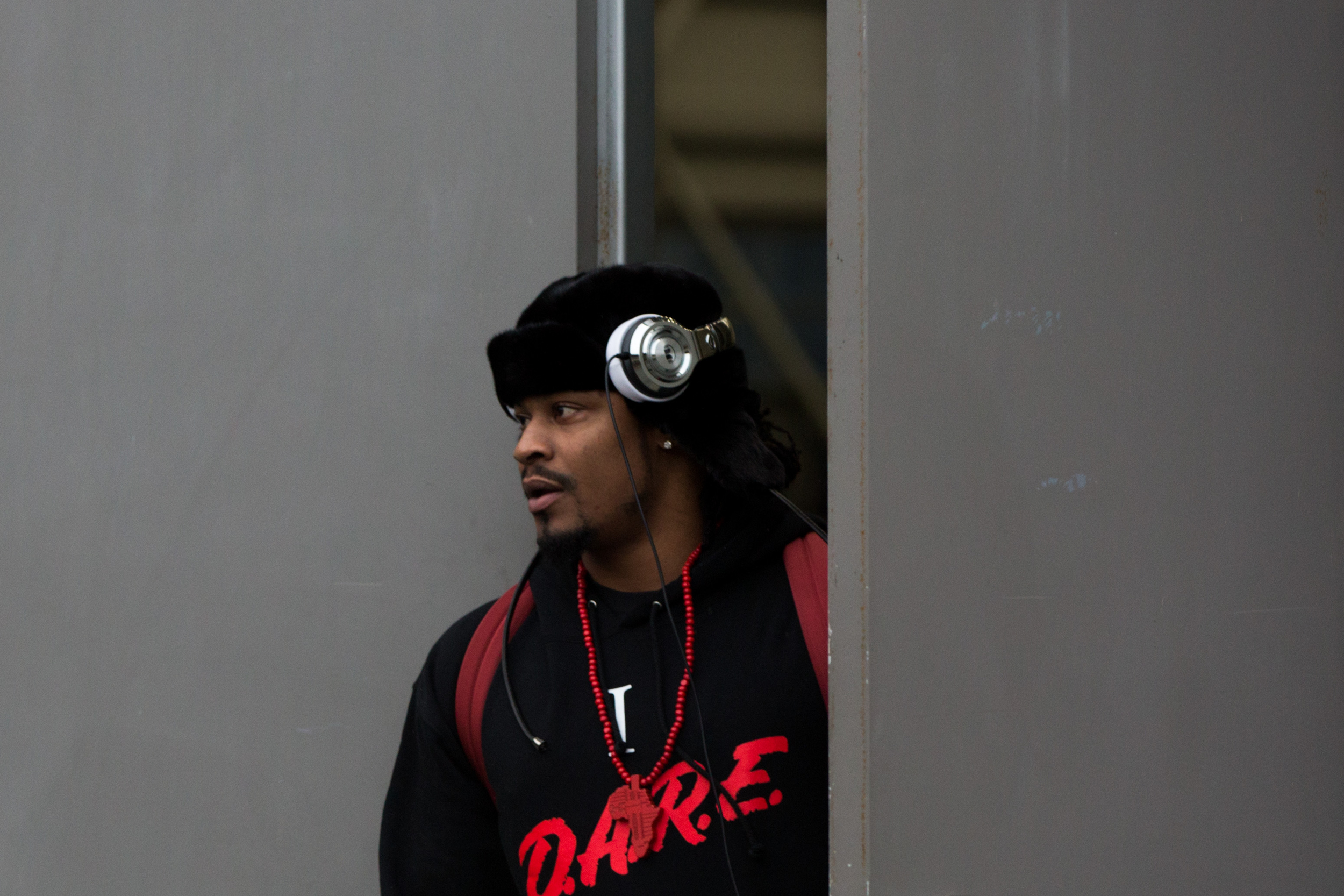 Seattle Seahawks running back Marshawn Lynch leaves the Virginia Mason Athletic Center to board a bus to travel to the team's NFL football game Sunday against the Carolina Panthers, Friday, Jan. 15, 2016, in Seattle. (Grant Hindsley/seattlepi.com via AP)