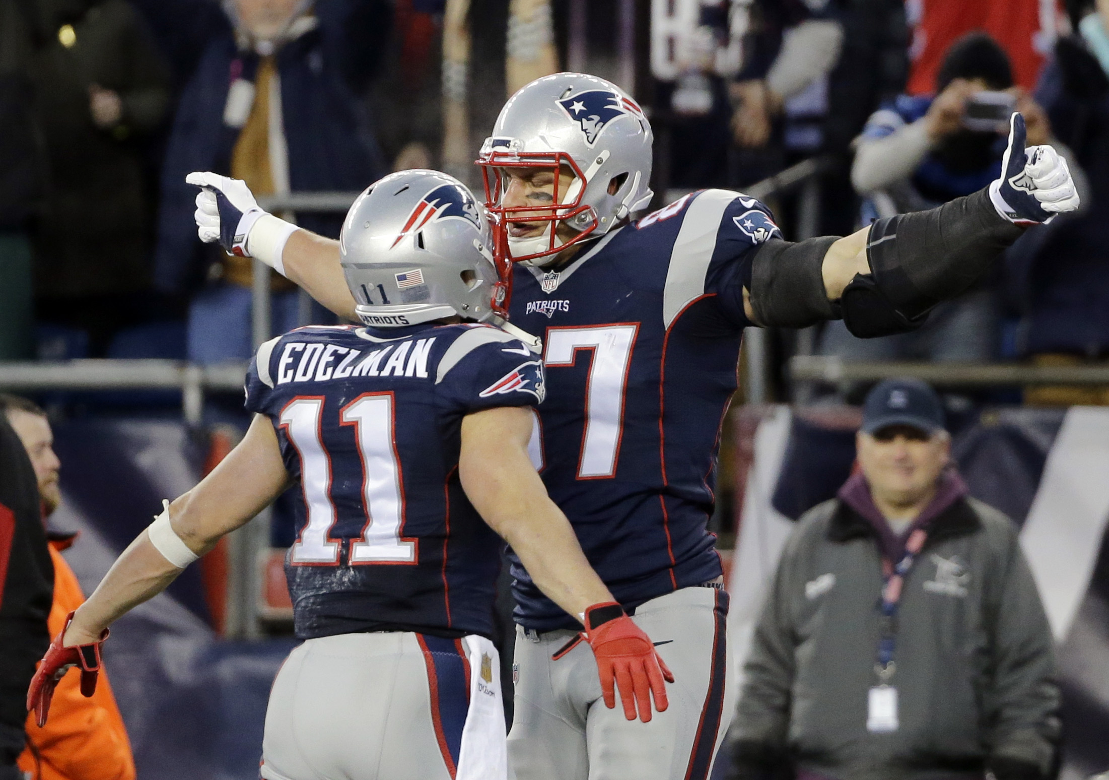 New England Patriots tight end Rob Gronkowski (87) celebrates his touchdown against the Kansas City Chiefs with teammate Julian Edelman (11) in the first half of an NFL divisional playoff football game, Saturday, Jan. 16, 2016, in Foxborough, Mass. (AP Ph