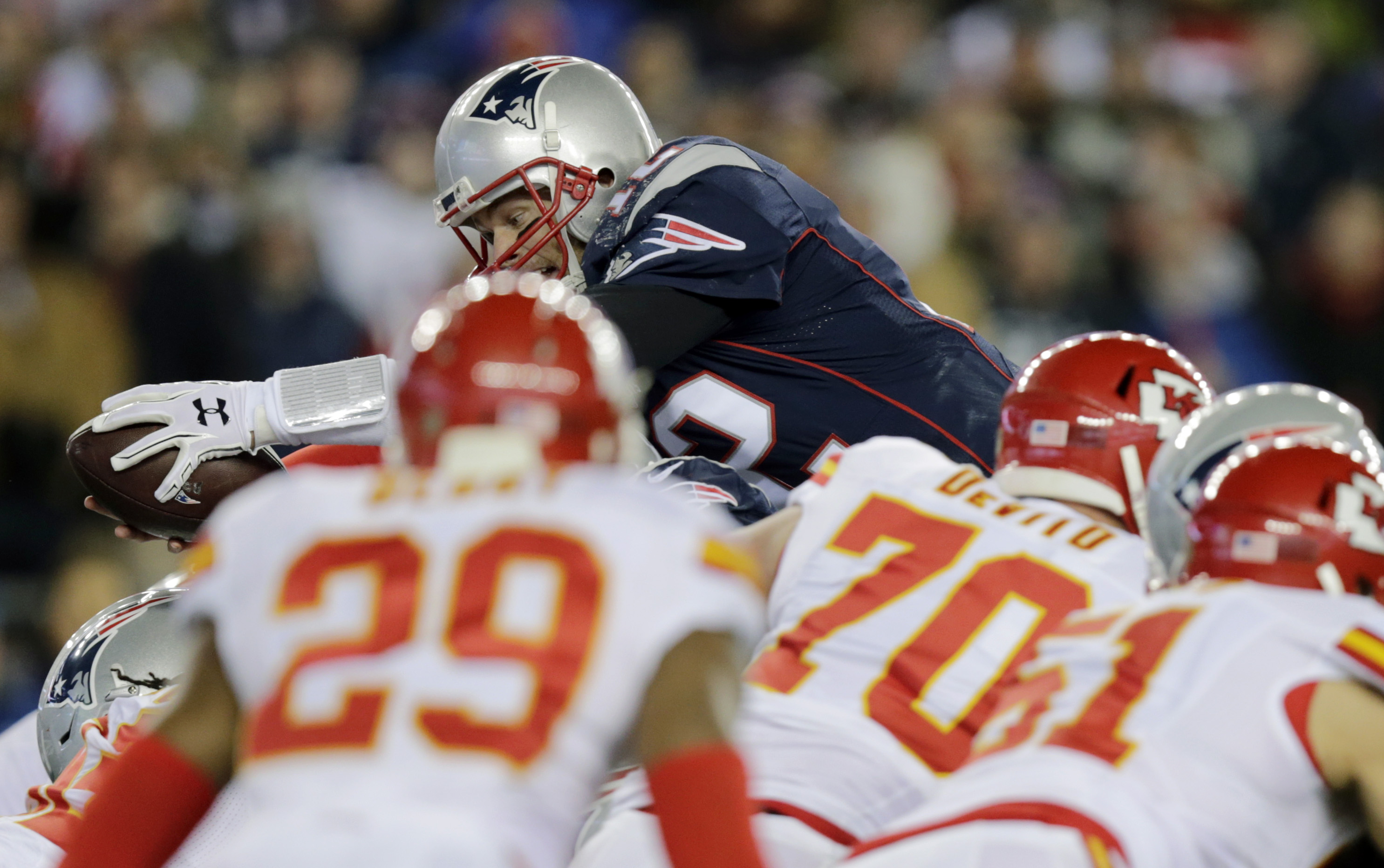 New England Patriots quarterback Tom Brady (12) goes over the top for a touchdown against the Kansas City Chiefs in the first half of an NFL divisional playoff football game, Saturday, Jan. 16, 2016, in Foxborough, Mass. (AP Photo/Charles Krupa)