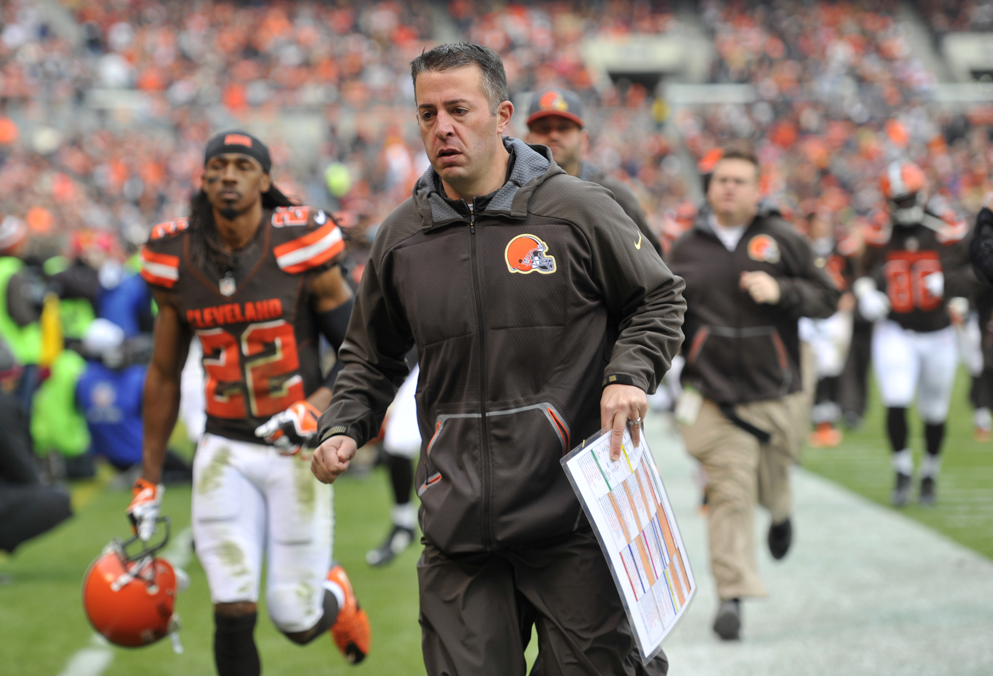 FILE - In this Dec. 6, 2015, file photo, Cleveland Browns offensive coordinator John DeFilippo runs off the field at halftime during the team's NFL football game against the Cincinnati Bengals in Cleveland. A person familiar with the decision says DeFilip