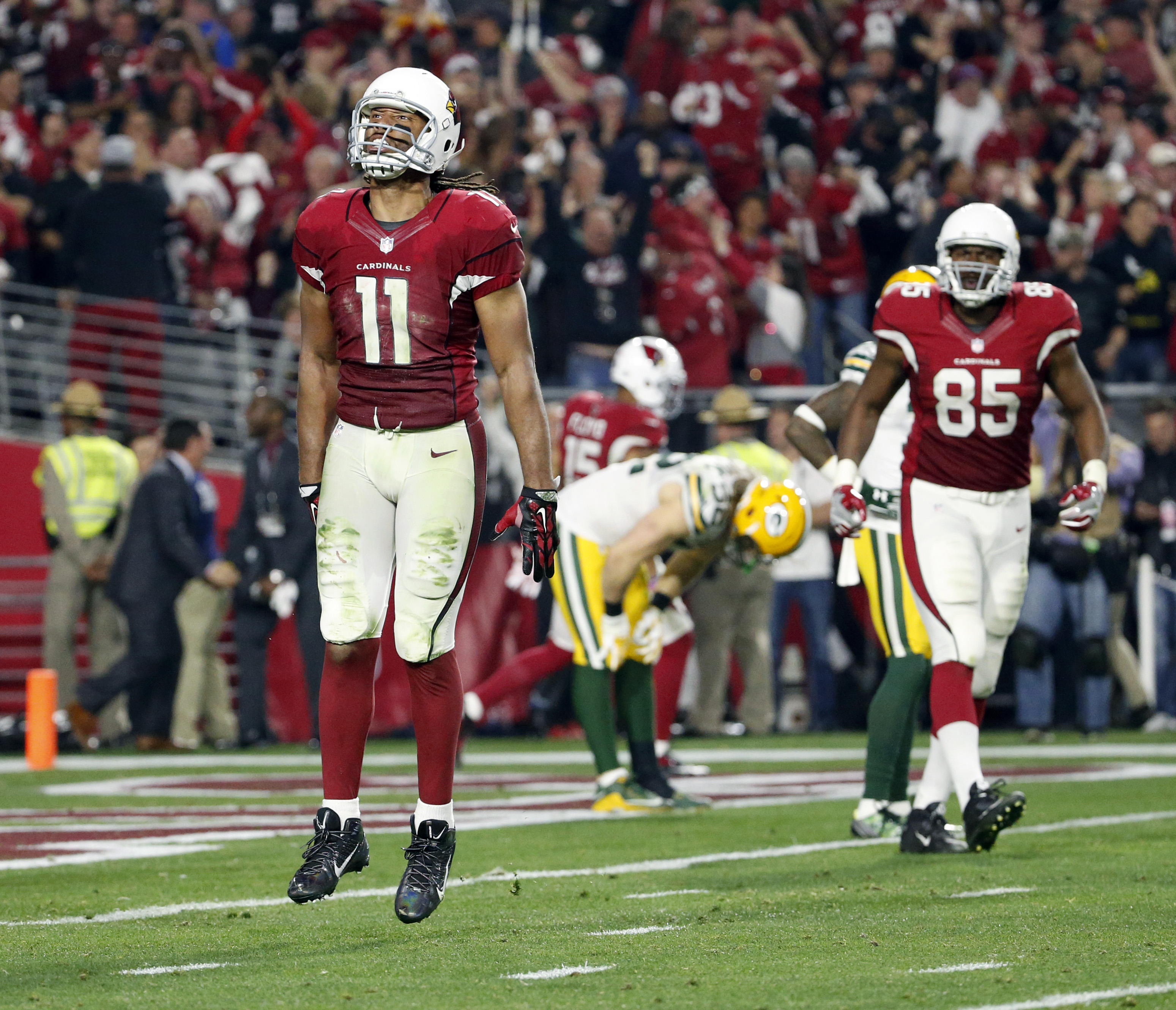 Arizona Cardinals wide receiver Larry Fitzgerald (11) celebrates his game winning touchdown against the Green Bay Packers during overtime of an NFL divisional playoff football game, Saturday, Jan. 16, 2016, in Glendale, Ariz. The Cardinals won 26-20 in ov