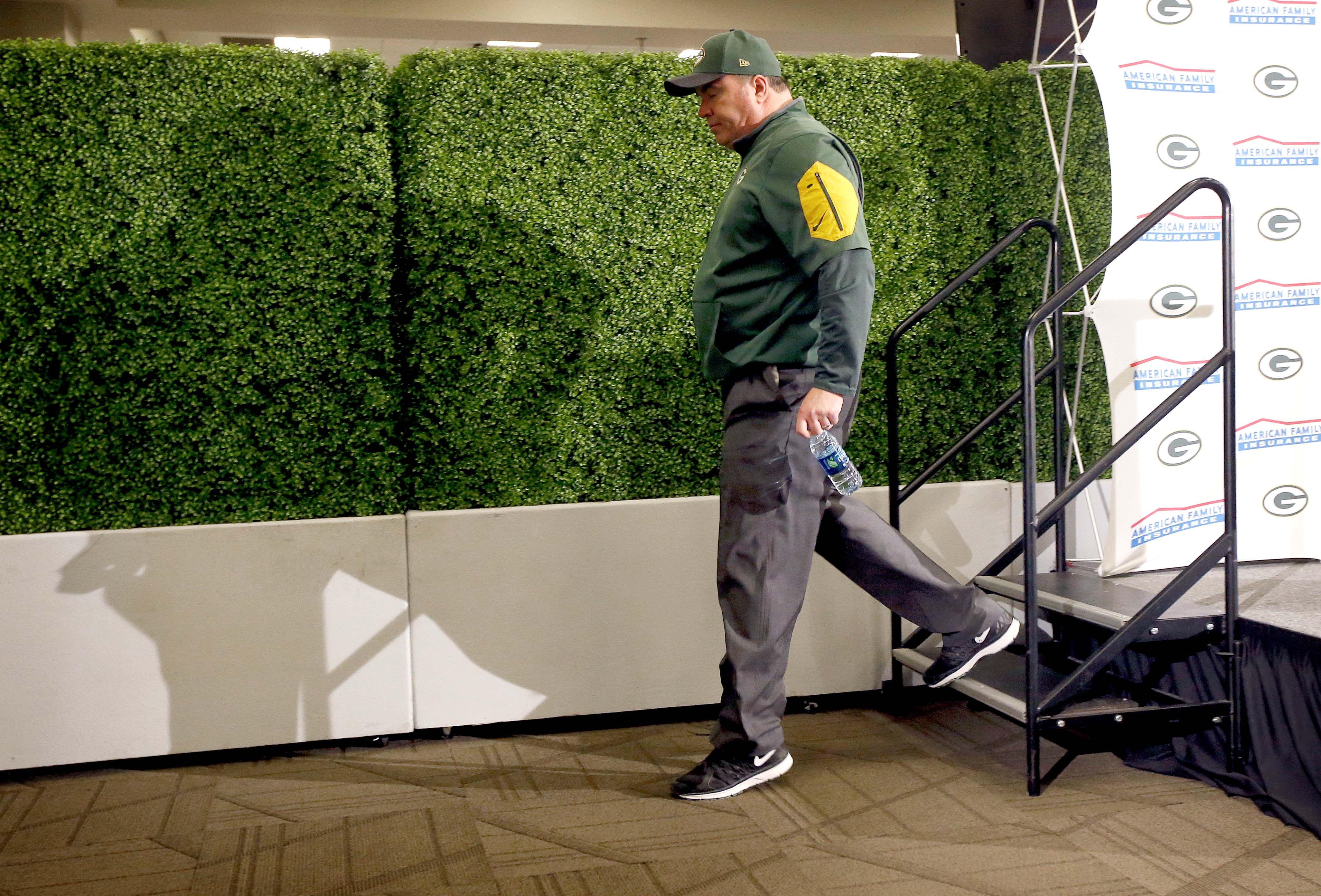 Green Bay Packers head coach Mike McCarthy leaves the podium after speaking to the media after an NFL divisional playoff football game against the Arizona Cardinals, Saturday, Jan. 16, 2016, in Glendale, Ariz. The Cardinals won 26-20 in overtime. (AP Phot