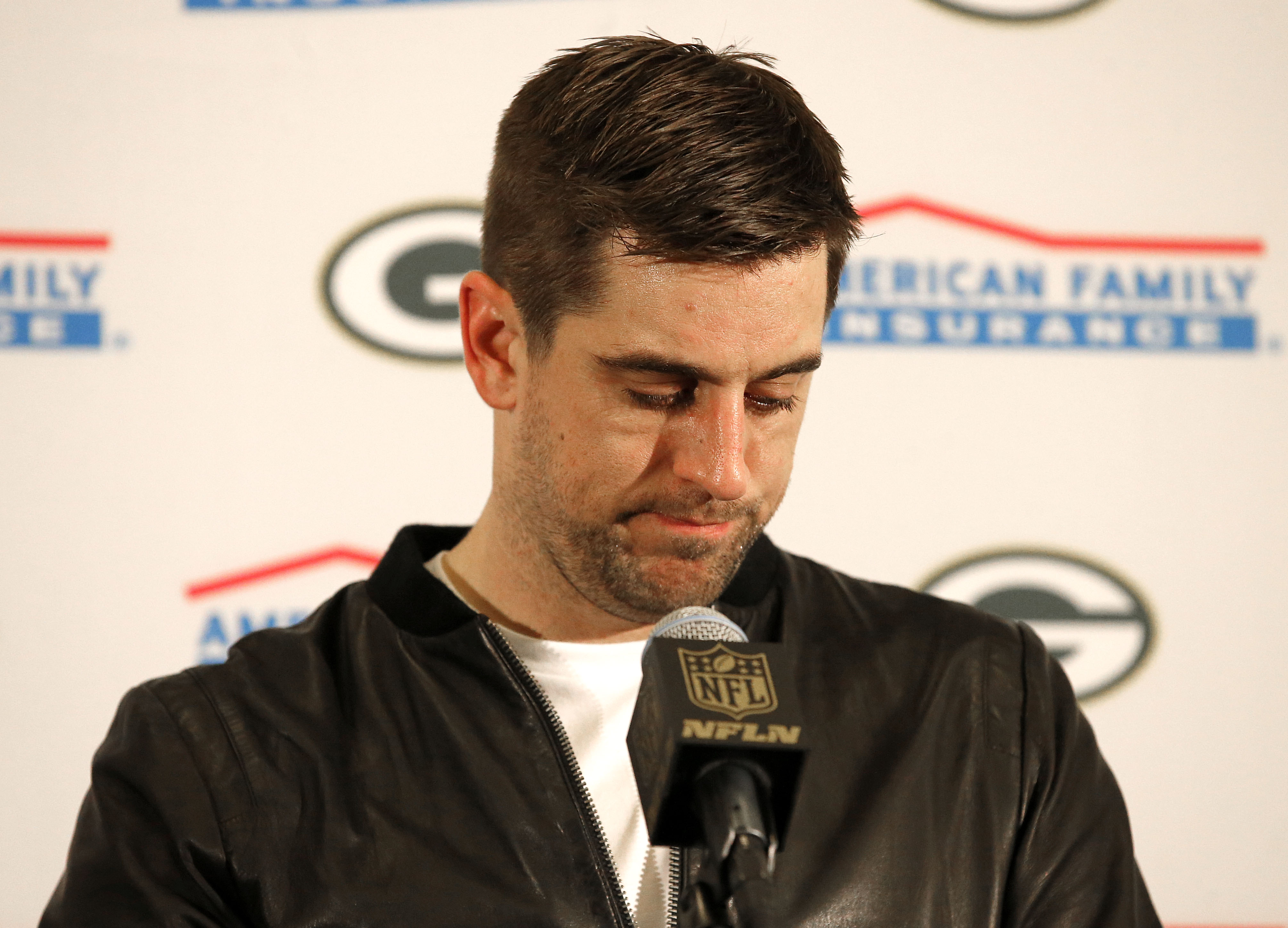 Green Bay Packers quarterback Aaron Rodgers speaks during a news conference after an NFL divisional playoff football game against the Arizona Cardinals, Saturday, Jan. 16, 2016, in Glendale, Ariz. The Cardinals won 26-20 in overtime. (AP Photo/Ross D. Fra