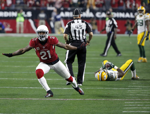 Arizona Cardinals cornerback Patrick Peterson (21) celebrates his fourth stop against the Green Bay Packers during the second half of an NFL divisional playoff football game, Saturday, Jan. 16, 2016, in Glendale, Ariz.  (AP Photo/Ross D. Franklin)