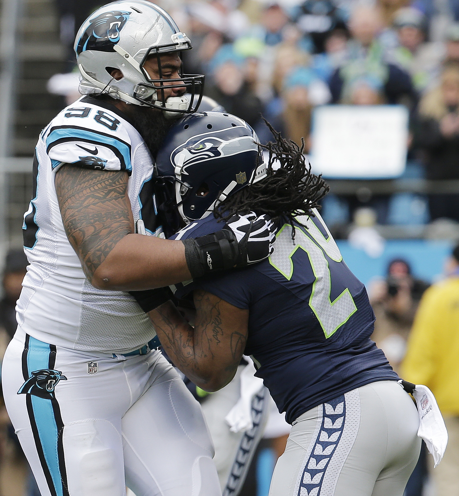 Carolina Panthers defensive tackle Star Lotulelei (98) stops Seattle Seahawks running back Marshawn Lynch (24) during the first half of an NFL divisional playoff football game, Sunday, Jan. 17, 2016, in Charlotte, N.C. (AP Photo/Chuck Burton)