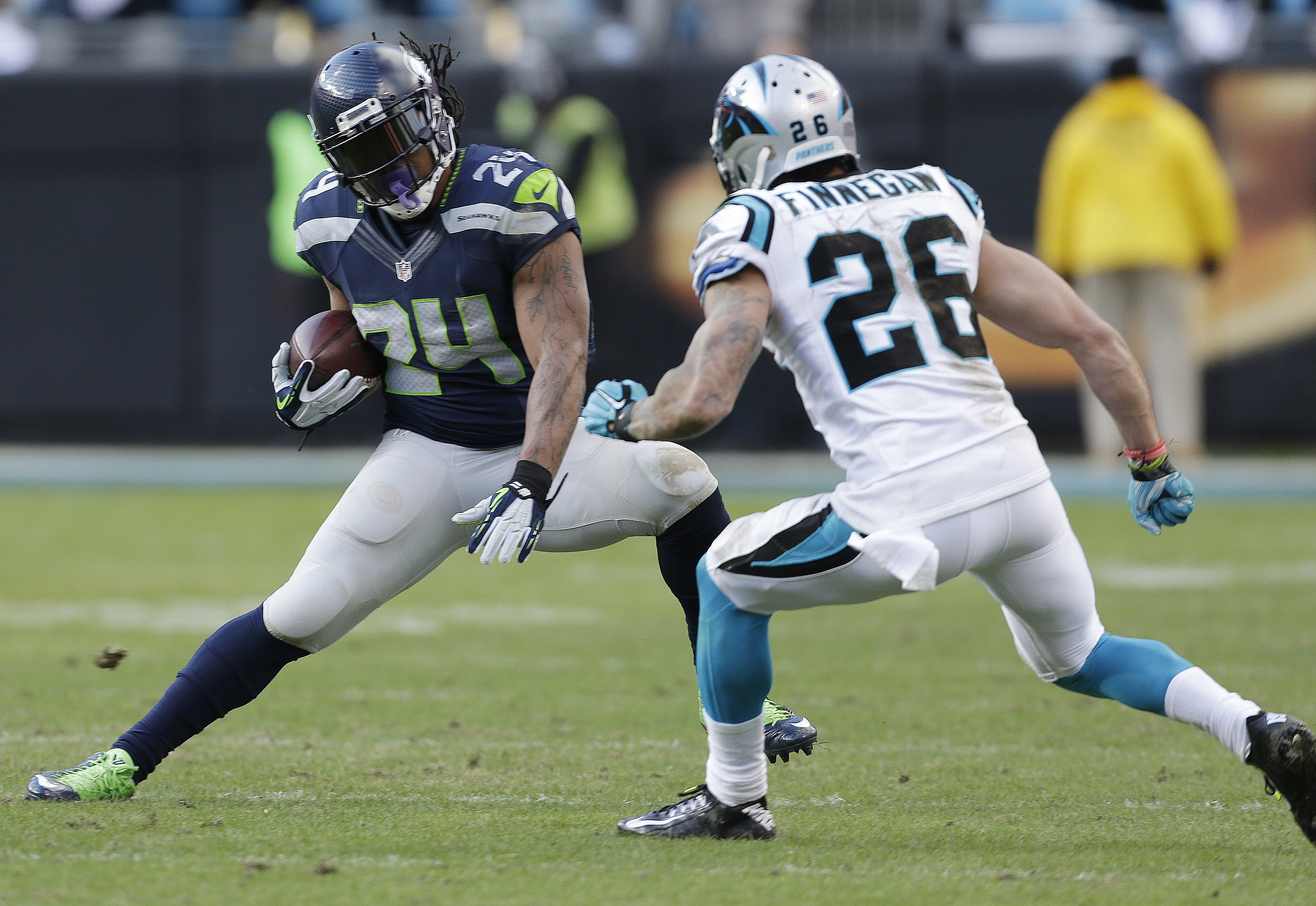 Seattle Seahawks running back Marshawn Lynch (24) moves against Carolina Panthers defensive back Cortland Finnegan (26) during the second half of an NFL divisional playoff football game, Sunday, Jan. 17, 2016, in Charlotte, N.C. (AP Photo/Bob Leverone)