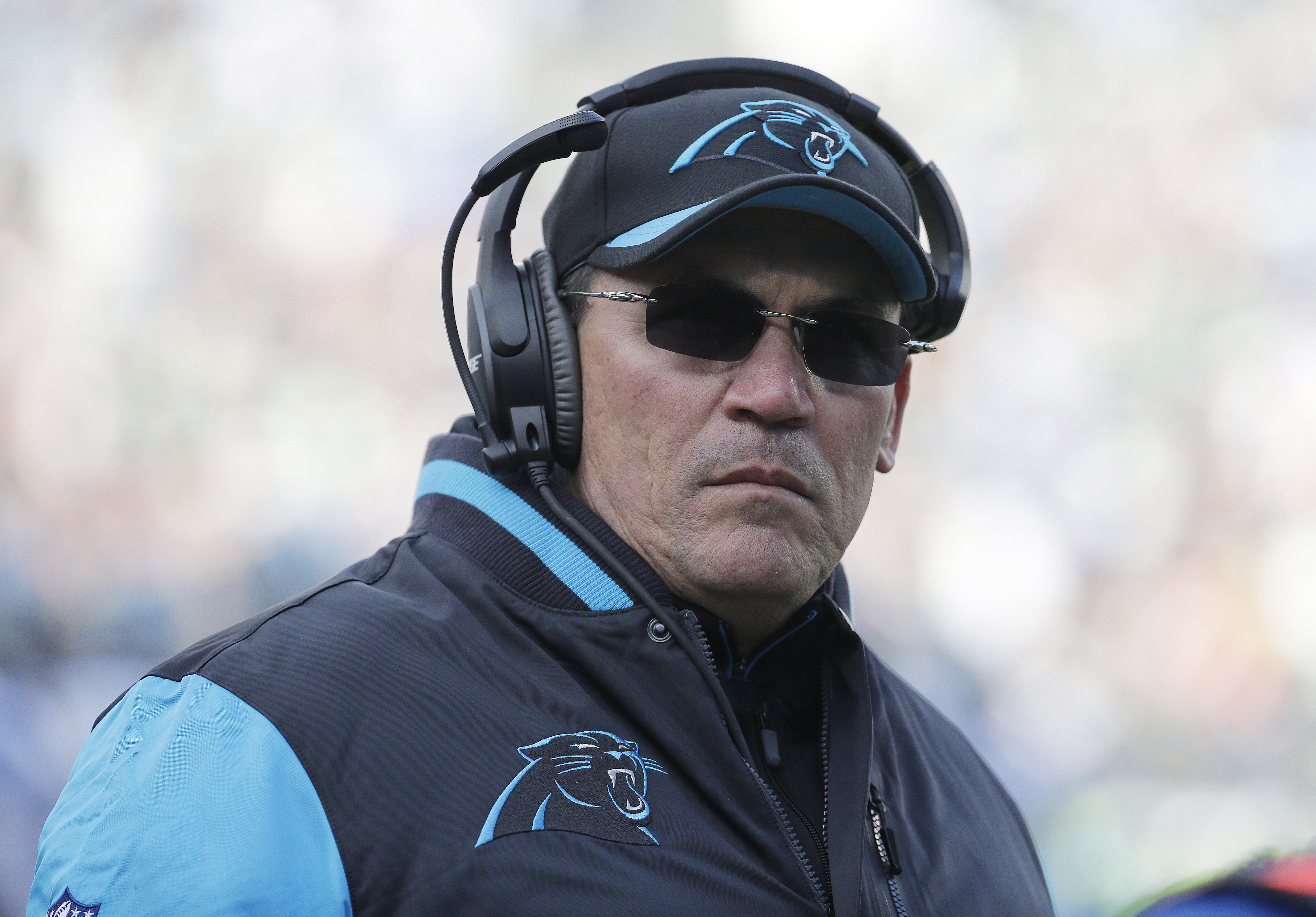Carolina Panthers head coach Ron Rivera walks on the sidelines during the second half of an NFL divisional playoff football game against the Seattle Seahawks, Sunday, Jan. 17, 2016, in Charlotte, N.C. (AP Photo/Chuck Burton)