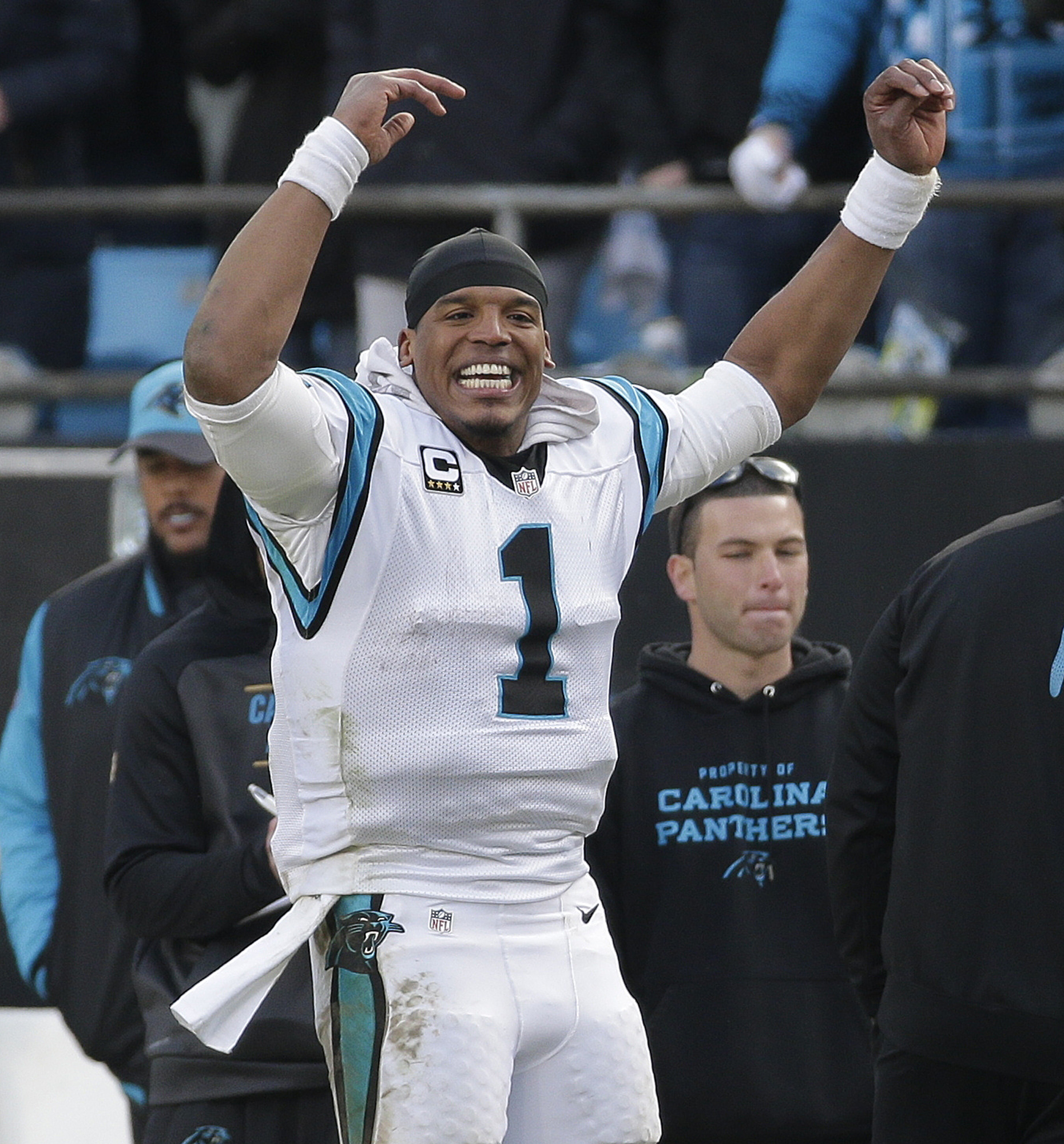 Carolina Panthers quarterback Cam Newton (1) cheers on the sidelines during the second half of an NFL divisional playoff football game against the Seattle Seahawks, Sunday, Jan. 17, 2016, in Charlotte, N.C. The Carolina Panthers won 31-24.(AP Photo/Chuck