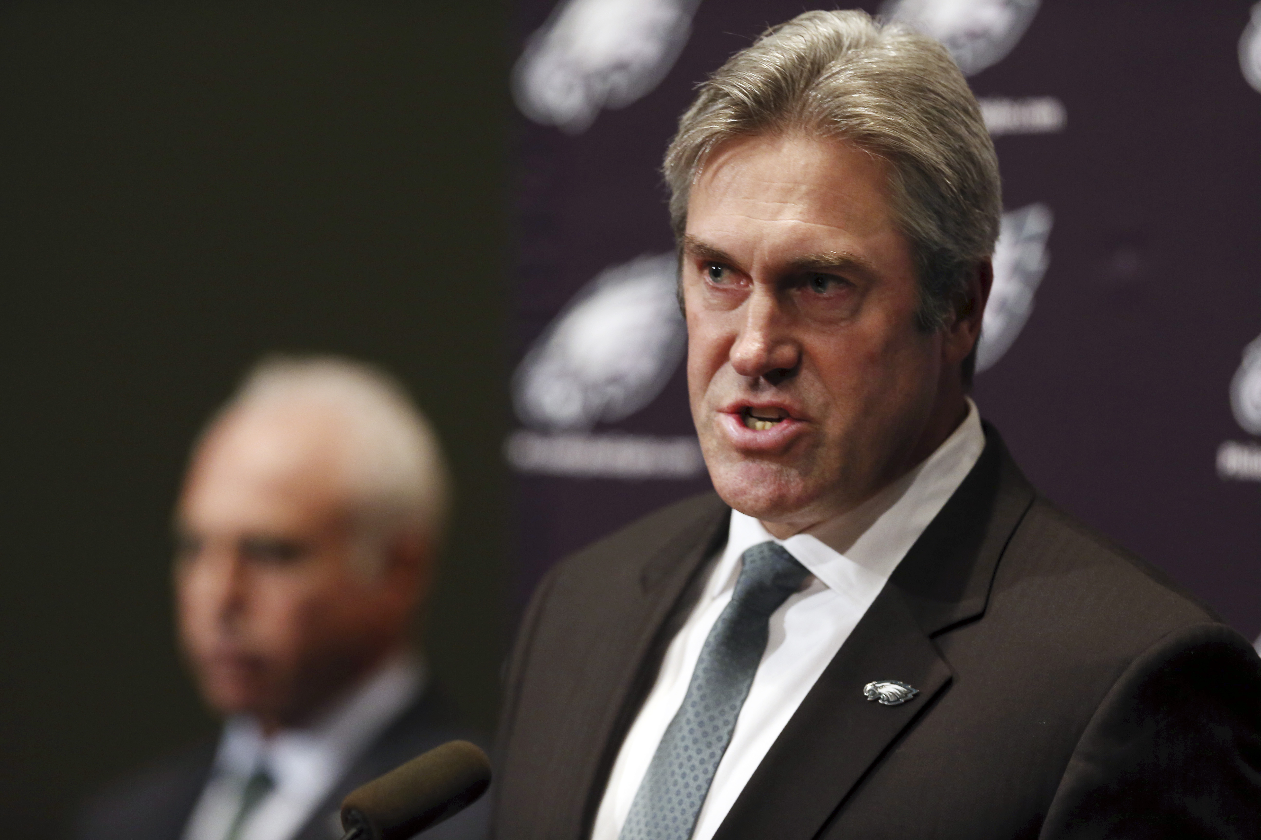 Philadelphia Eagles owner Jeffrey Lurie, left, listens as Doug Pederson, right, answers a question after he was introduced as the NFL football team's new head coach during news conference, Tuesday, Jan. 19, 2016, in Philadelphia. (AP Photo/Mel Evans)