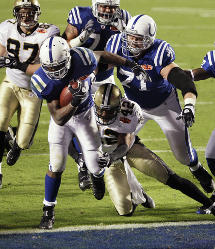 FILE - In this Feb. 7, 2010, file photo, Indianapolis Colts running back Joseph Addai (29) runs in a 4-yard touchdown as New Orleans Saints safety Darren Sharper (42) defends during the second half of NFL football's Super Bowl XLIV in Miami. The Saints wo
