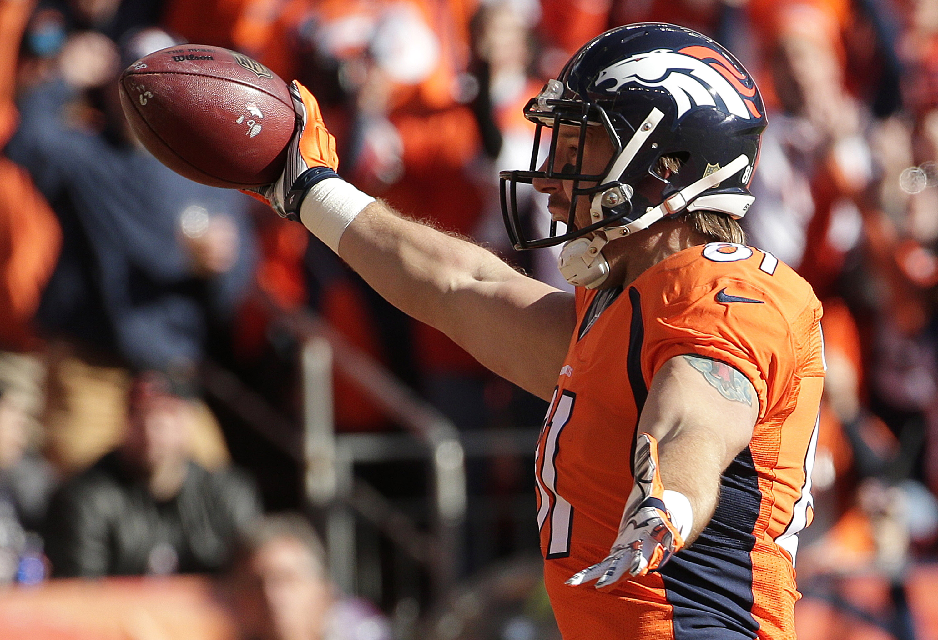 Denver Broncos tight end Owen Daniels celebrates after catching a 21-yard touchdown pass from quarterback Peyton Manning during the first half the NFL football AFC Championship game between the Denver Broncos and the New England Patriots, Sunday, Jan. 24,