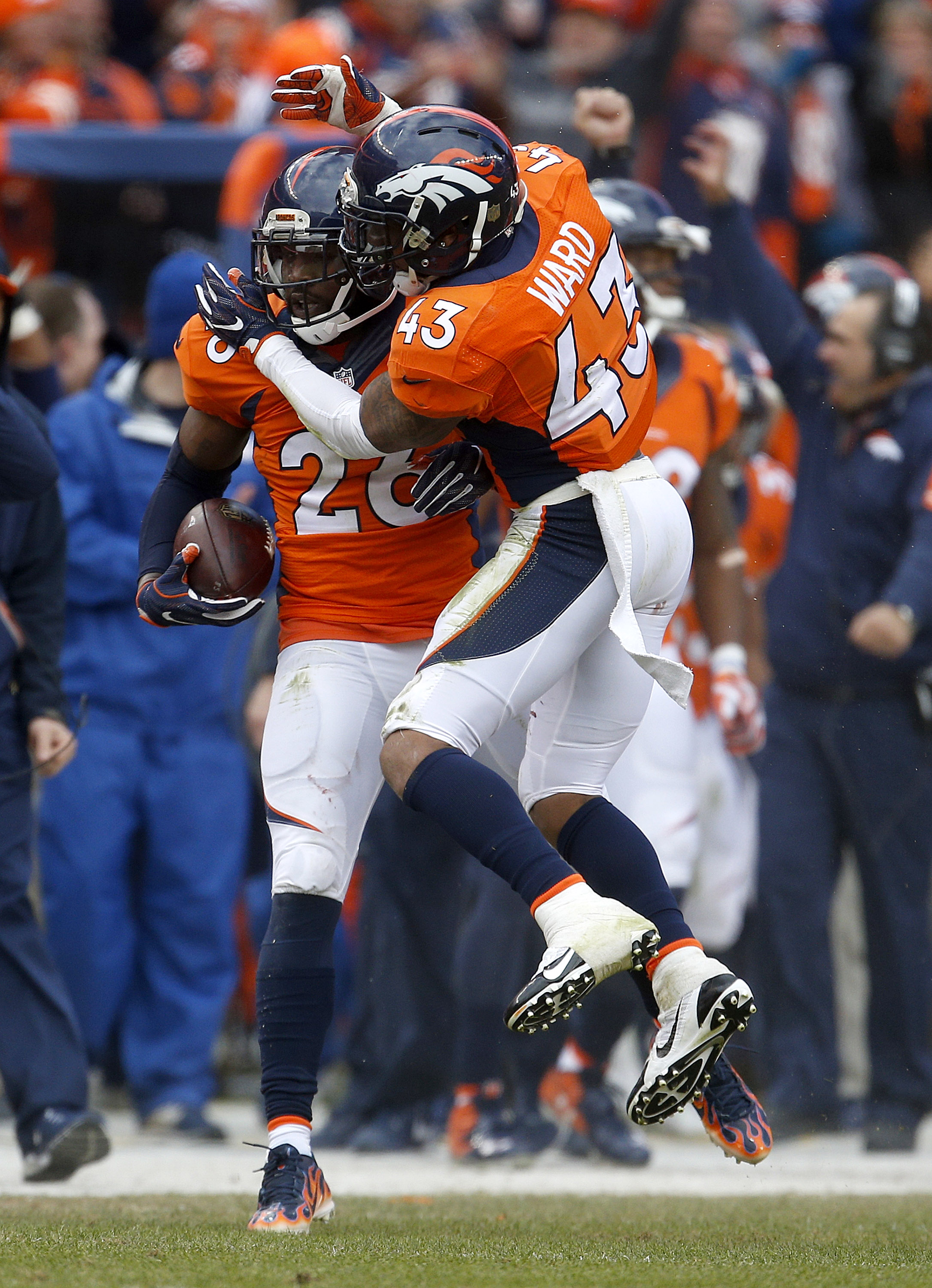 Denver Broncos free safety Darian Stewart (26) is congratulated by teammate T.J. Ward after intercepting a pass from New England Patriots quarterback Tom Brady during the first half the NFL football AFC Championship game between the Denver Broncos and the