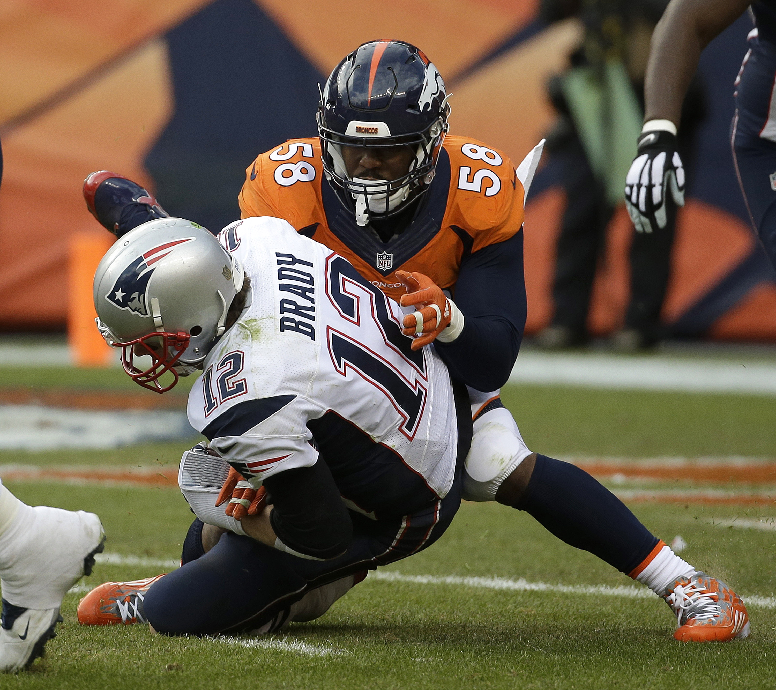 New England Patriots quarterback Tom Brady is sacked by Denver Broncos outside linebacker Von Miller during the second half of the NFL football AFC Championship game between the Denver Broncos and the New England Patriots, Sunday, Jan. 24, 2016, in Denver