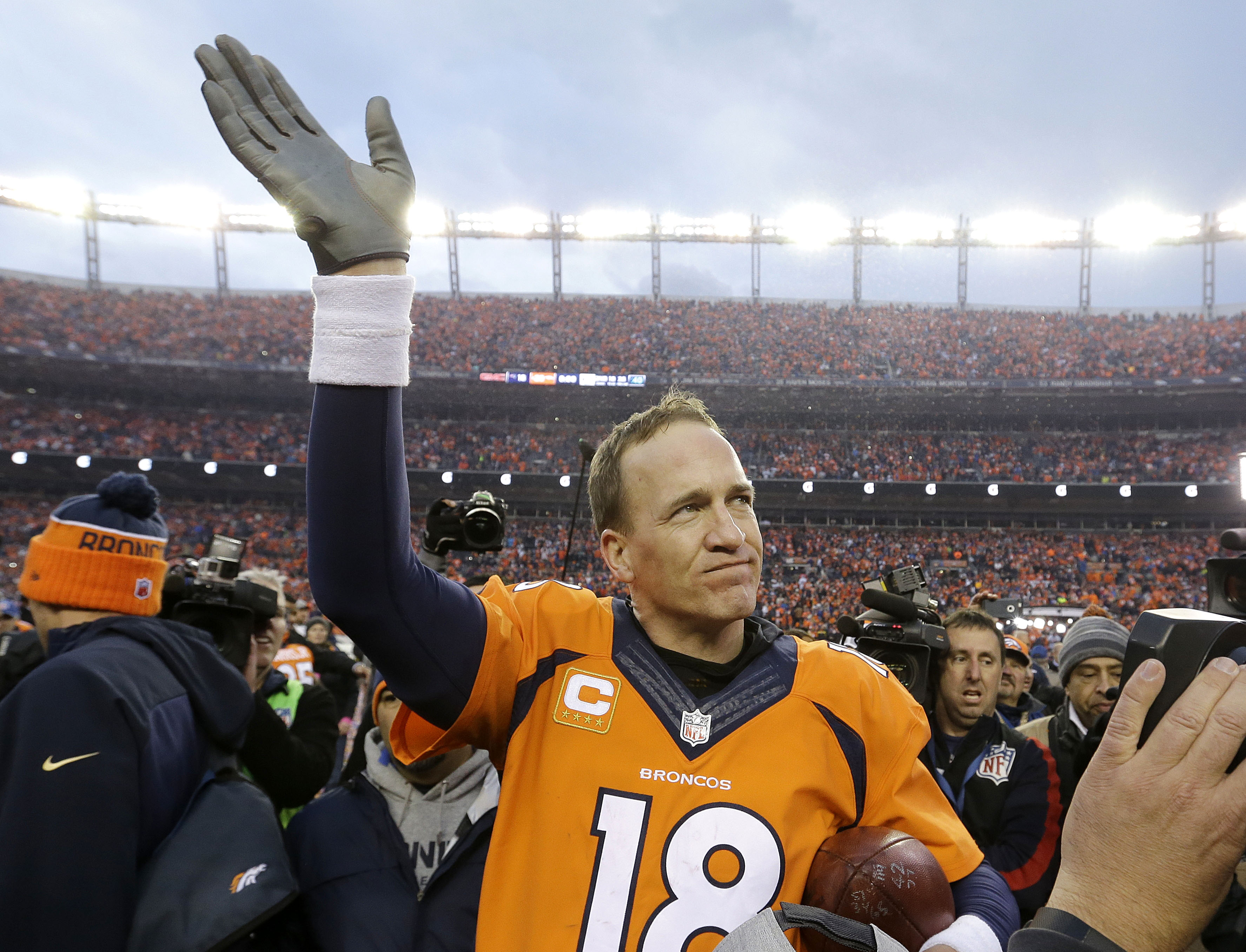 Denver Broncos quarterback Peyton Manning waves to spectators following the AFC Championship game between the Denver Broncos and the New England Patriots, Sunday, Jan. 24, 2016, in Denver. The Broncos defeated the Patriots 20-18 to advance to the Super Bo