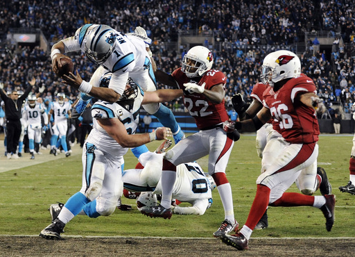 Carolina Panthers' Cam Newton leaps into the end zone for a touchdown run during the second half the NFL football NFC Championship game against the Arizona Cardinals Sunday, Jan. 24, 2016, in Charlotte, N.C. (AP Photo/Mike McCarn)