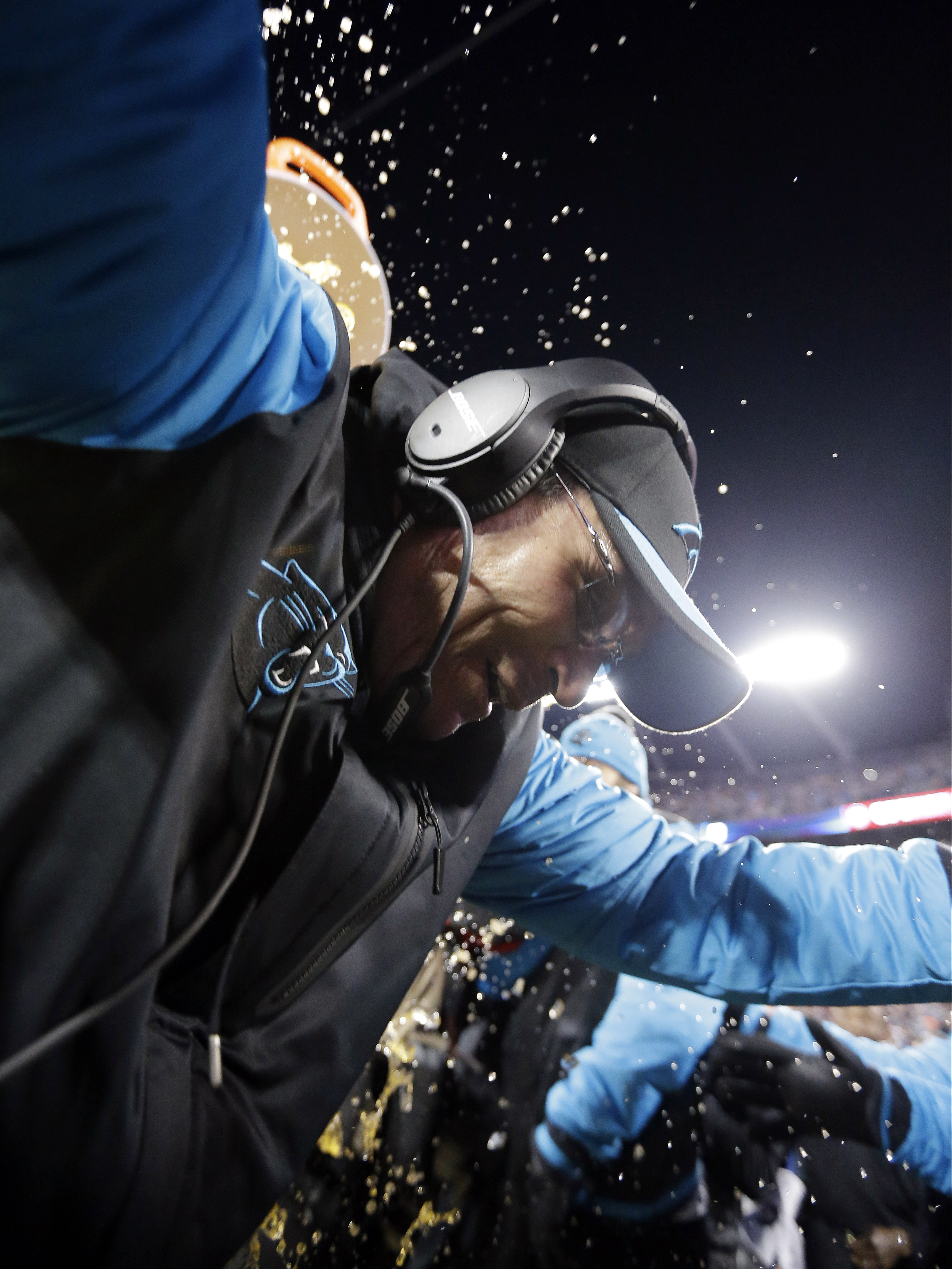 Carolina Panthers head coach Ron Rivera is dunks after the NFL football NFC Championship game against the Arizona Cardinals Sunday, Jan. 24, 2016, in Charlotte, N.C. The Panthers won 49-15 to advance to the Super Bowl. (AP Photo/David J. Phillip)