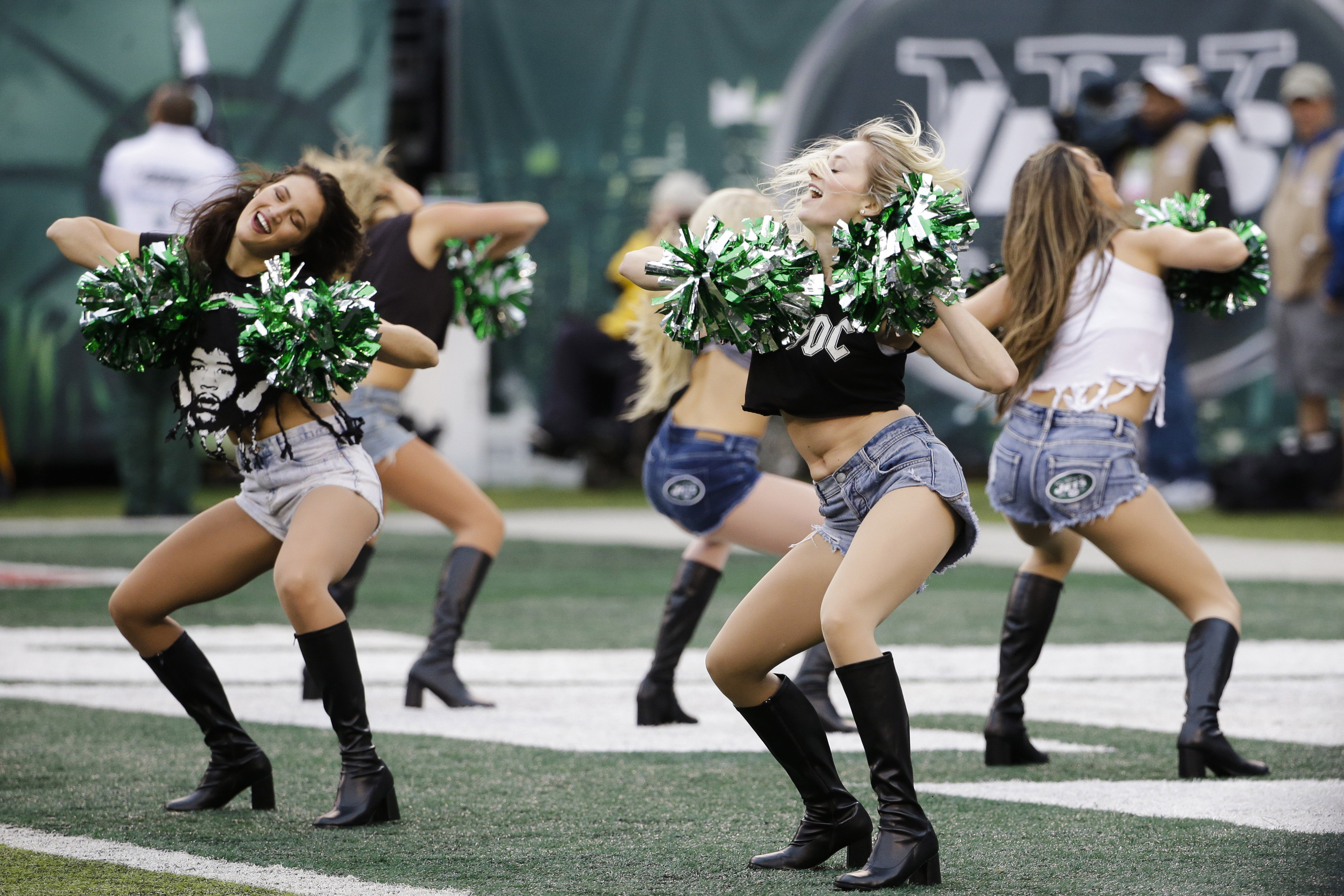 FILE - In this Dec. 27, 2015 file photo, New York Jets cheerleaders perform during the first half of an NFL football game against the New England Patriots in East Rutherford, N.J. The New York Jets have agreed to pay nearly $324,000 to settle a class-acti
