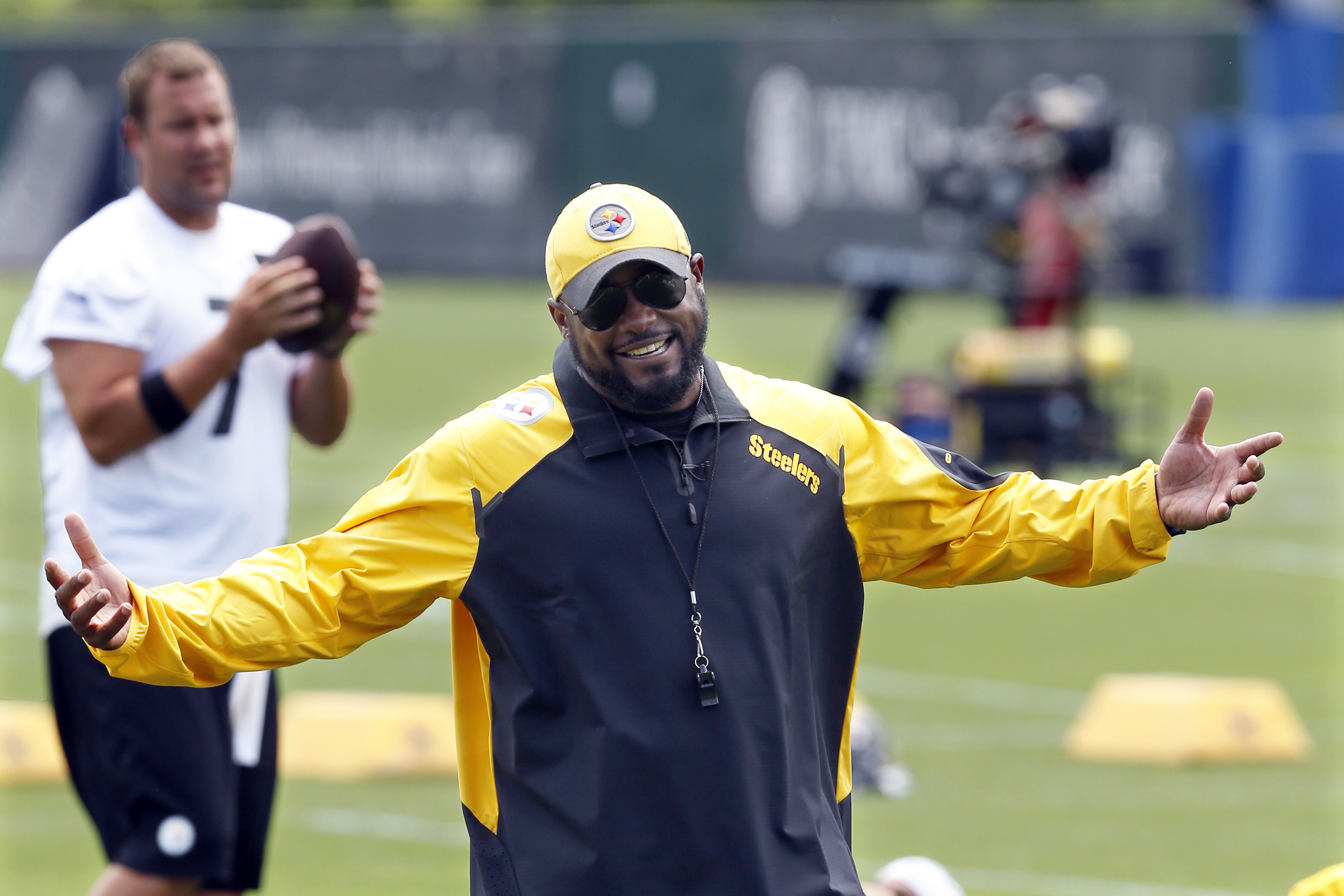 FILE - This file photo from June 16, 2015, shows Pittsburgh Steelers quarterback Ben Roethlisberger (7), left, watching as head coach Mike Tomlin jokes with the defensive backs during the 2015 NFL football mini camp in Pittsburgh. Steelers President Art R