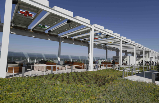 In this photo from Thursday, July 17, 2014, solar panels and a green roof are shown on on the top of Levi's Stadium in Santa Clara, Calif. When the architects set out to design a new football stadium for the San Francisco 49ers, they wanted a building tha
