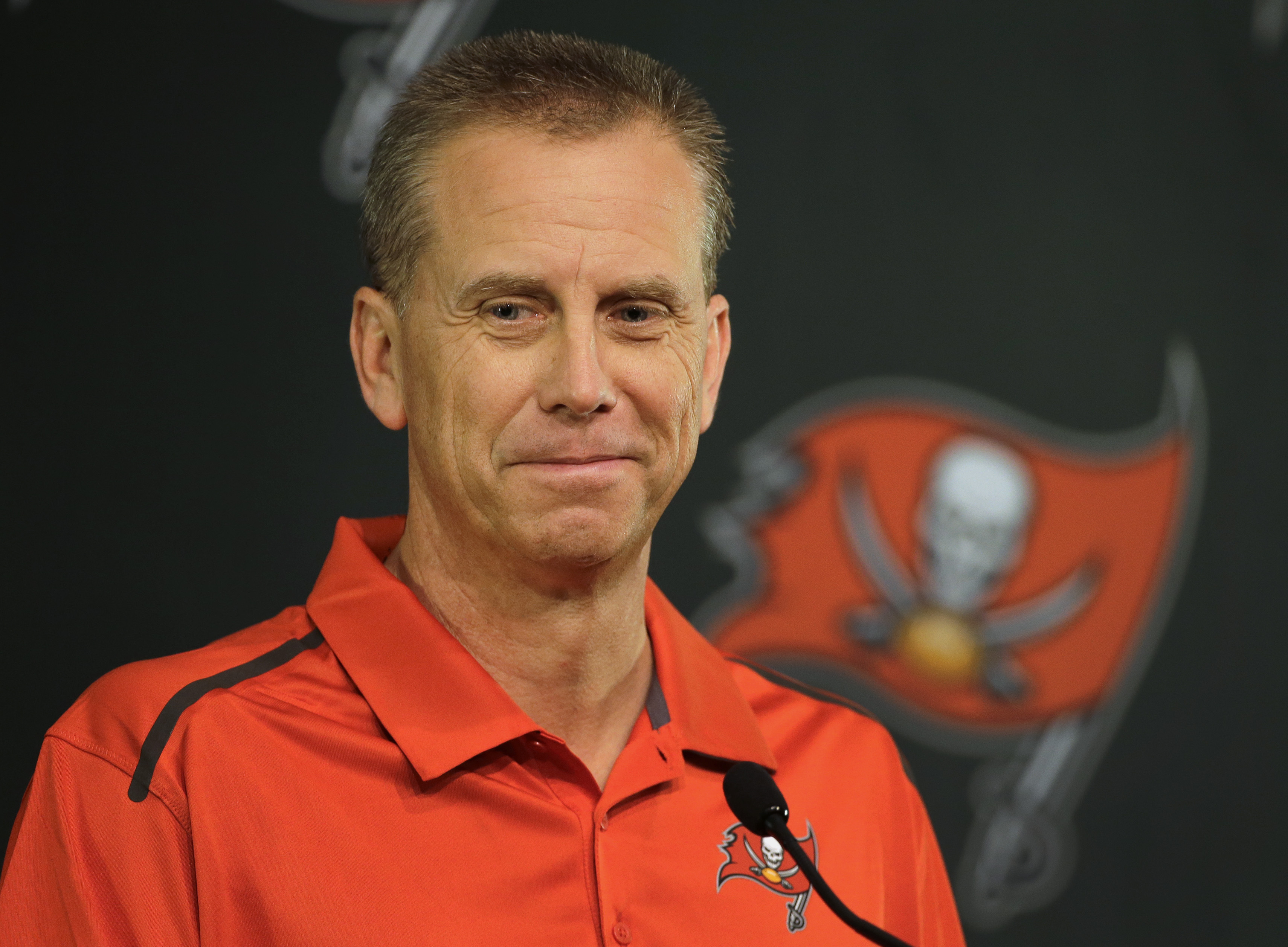 New Tampa Bay Buccaneers offensive coordinator Todd Monken smiles as he listens to a question during a news conference at the team's training facility Thursday, Jan. 28, 2016, in Tampa, Fla. Monken will also be the wide receivers coach. He was formerly th