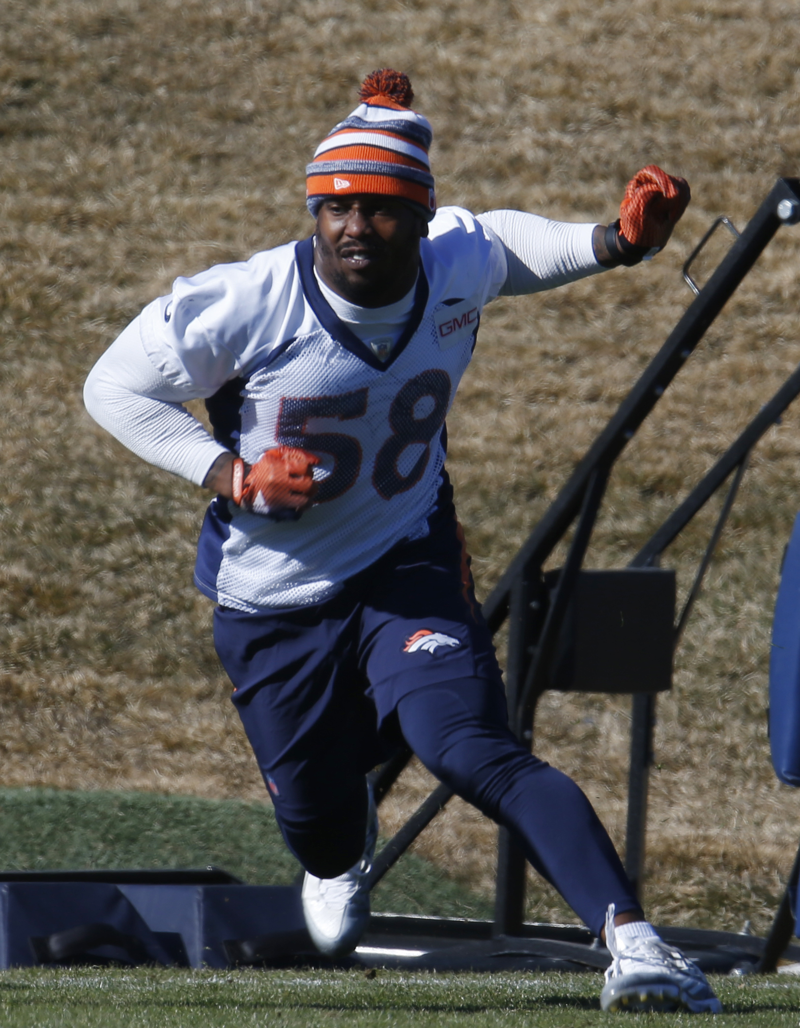 Denver Broncos outside linebacker Von Miller runs through a drill during an NFL football practice at the team's headquarters Thursday, Jan. 28, 2016, in Englewood, Colo. The Broncos are preparing to face the Carolina Panthers in the Super Bowl. (AP Photo/