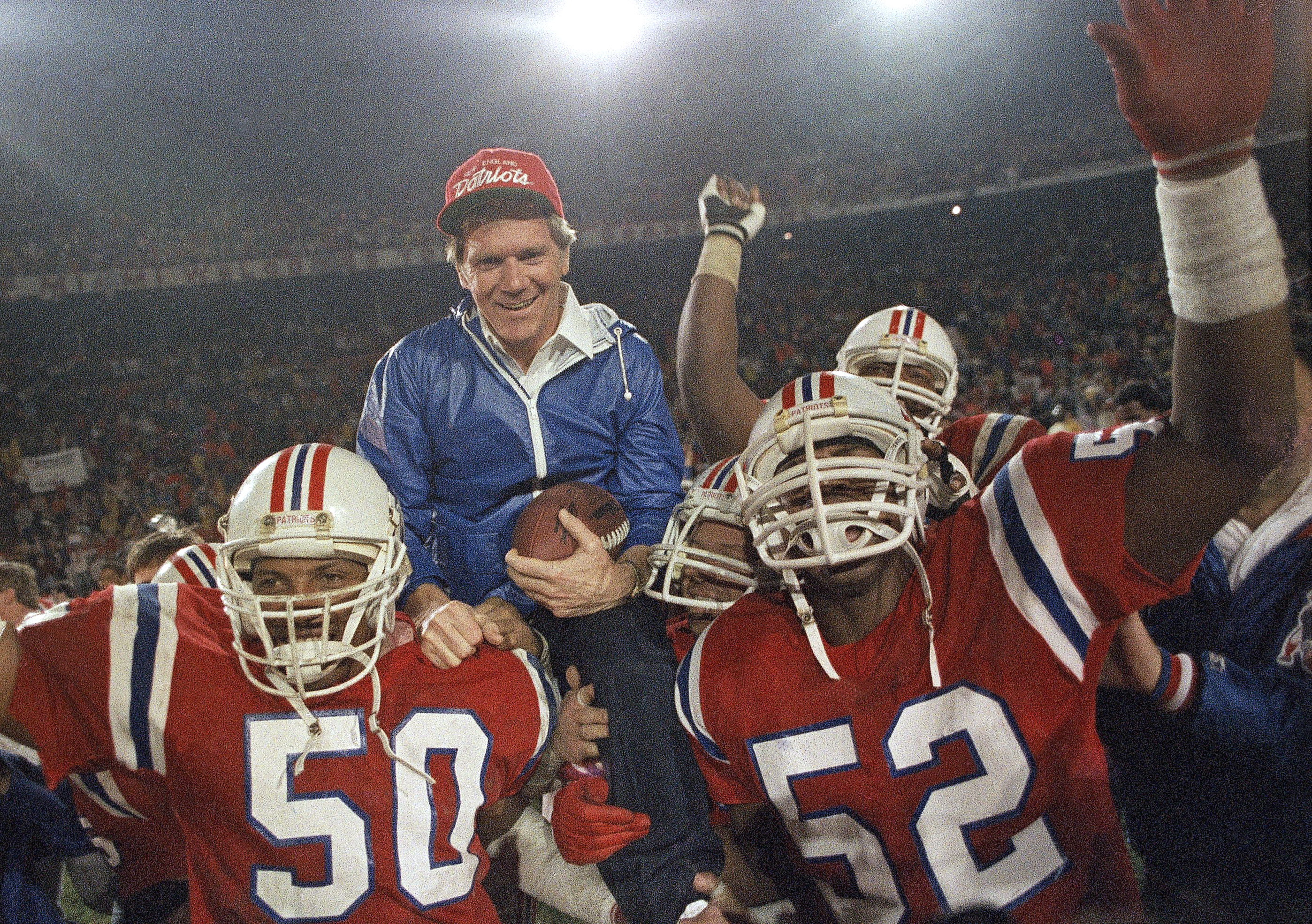 FILE - IN this Jan. 12, 1986, file photo, New England Patriots coach Raymond Berry gets a victory ride from players Larry McGrew (50) and Johnny Rembert (52) after the Patriots defeated the Miami Dolphins 31-14 in the NFL football AFC playoffs in Miami. T