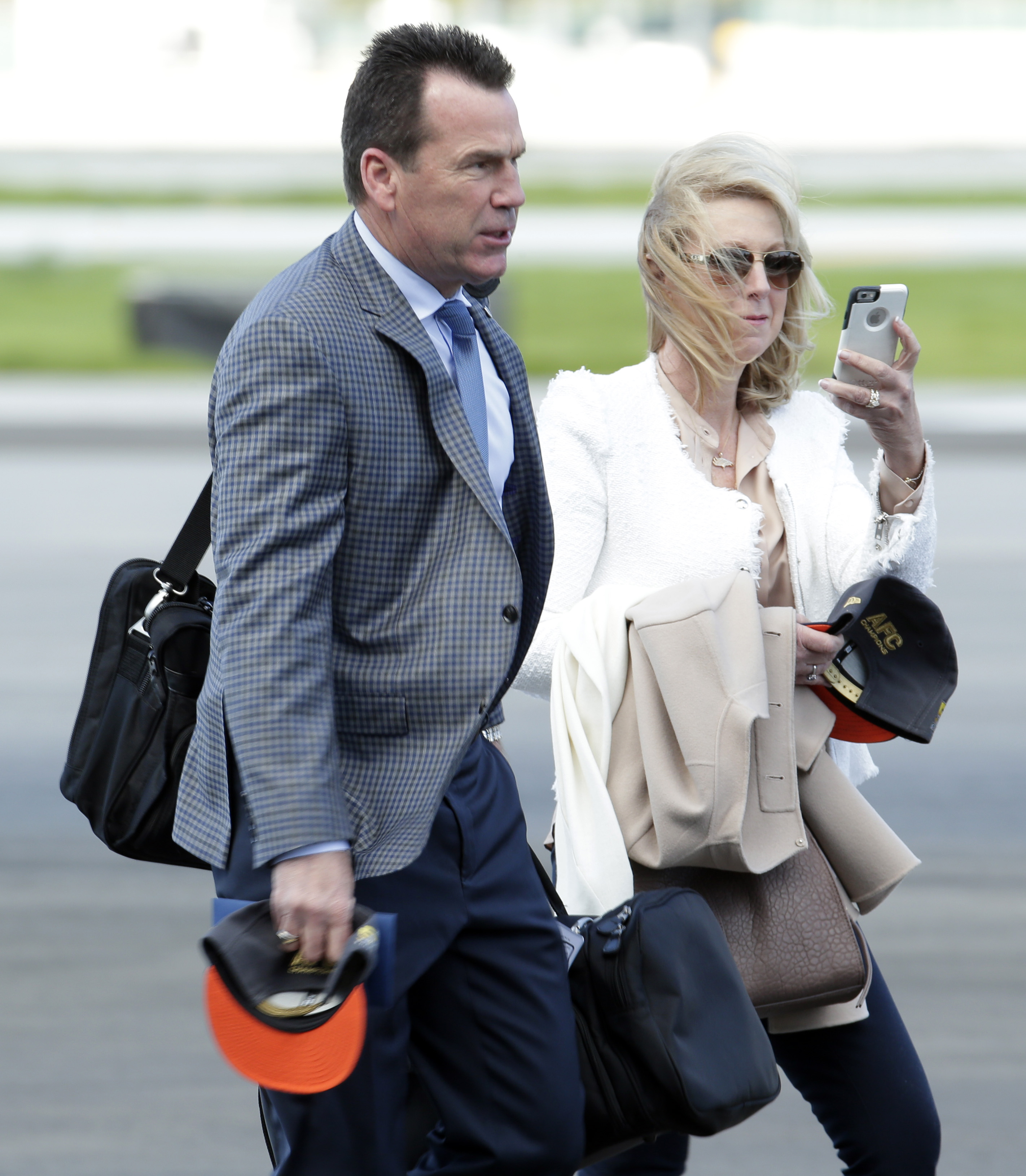 Denver Broncos head coach Gary Kubiak and wife Rhonda get off the plane as they arrive at the Mineta San Jose International Airport for the NFL Super Bowl football game Sunday, Jan. 31, 2016, in San Jose, Calif.  The Broncos play the Carolina Panthers on