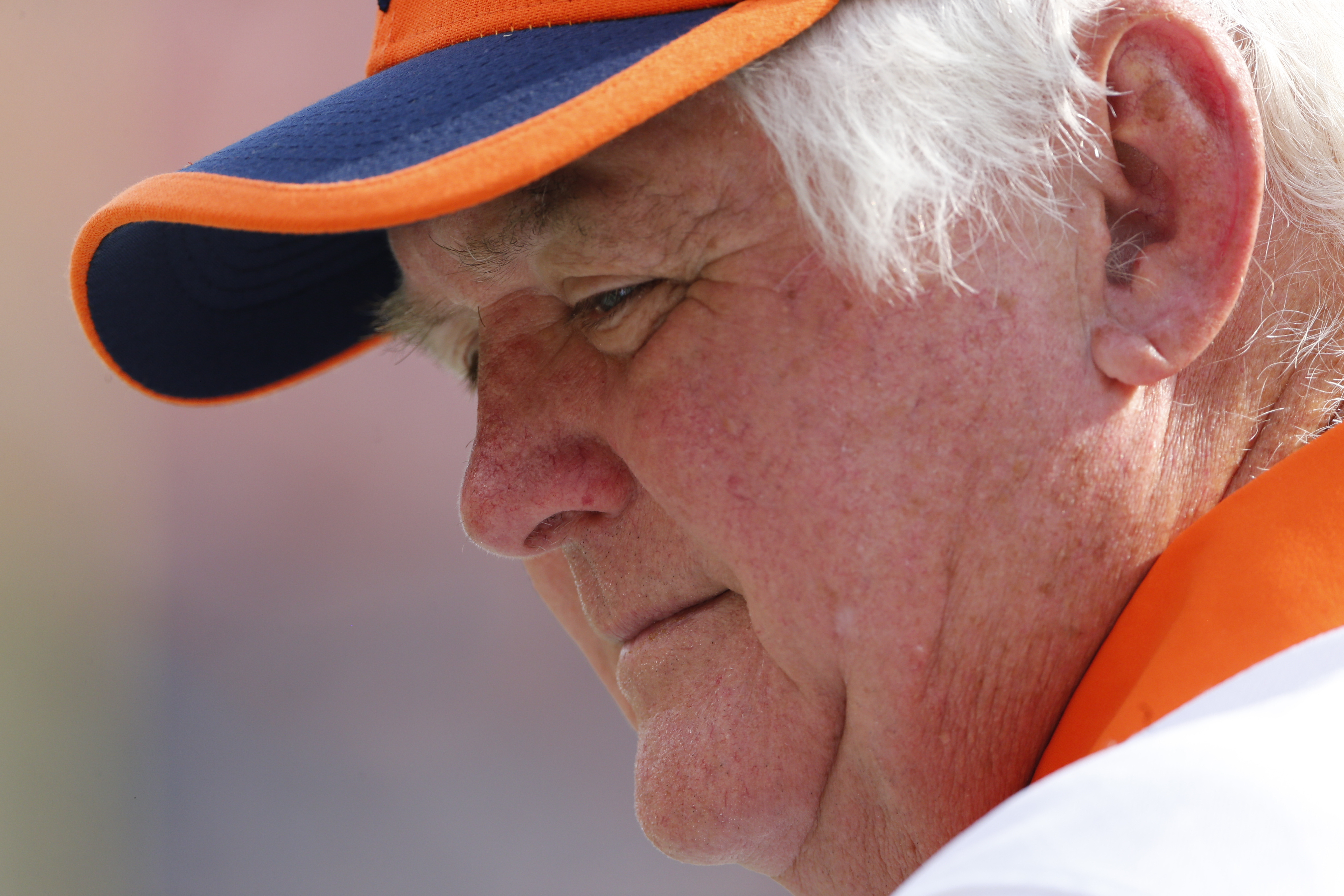 FILE - In this Sept. 13, 2015, file photo, Denver Broncos defensive coordinator Wade Phillips looks on during an NFL football game against the Baltimore Ravens in Denver. The Broncos defensive coordinator is a character cut from the same cloth as his dad,
