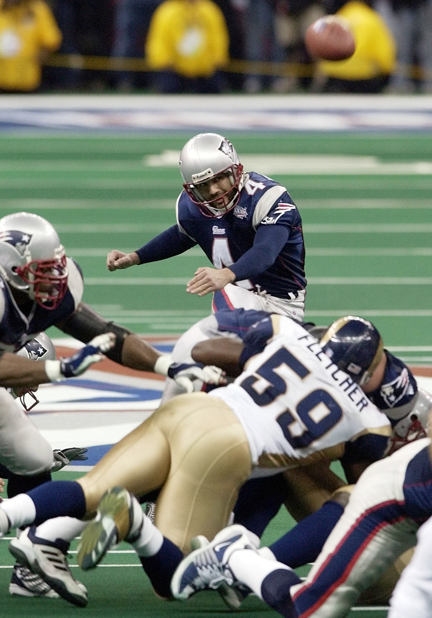 FILE - In this Feb. 3, 2002, file photo, New England Patriots kicker Adam Vinatieri kicks the game-winning 48-yard field goal in the final seconds to beat the St. Louis Rams 20-17 in Super Bowl XXXVI in New Orleans. When the Super Bowl comes down to the k