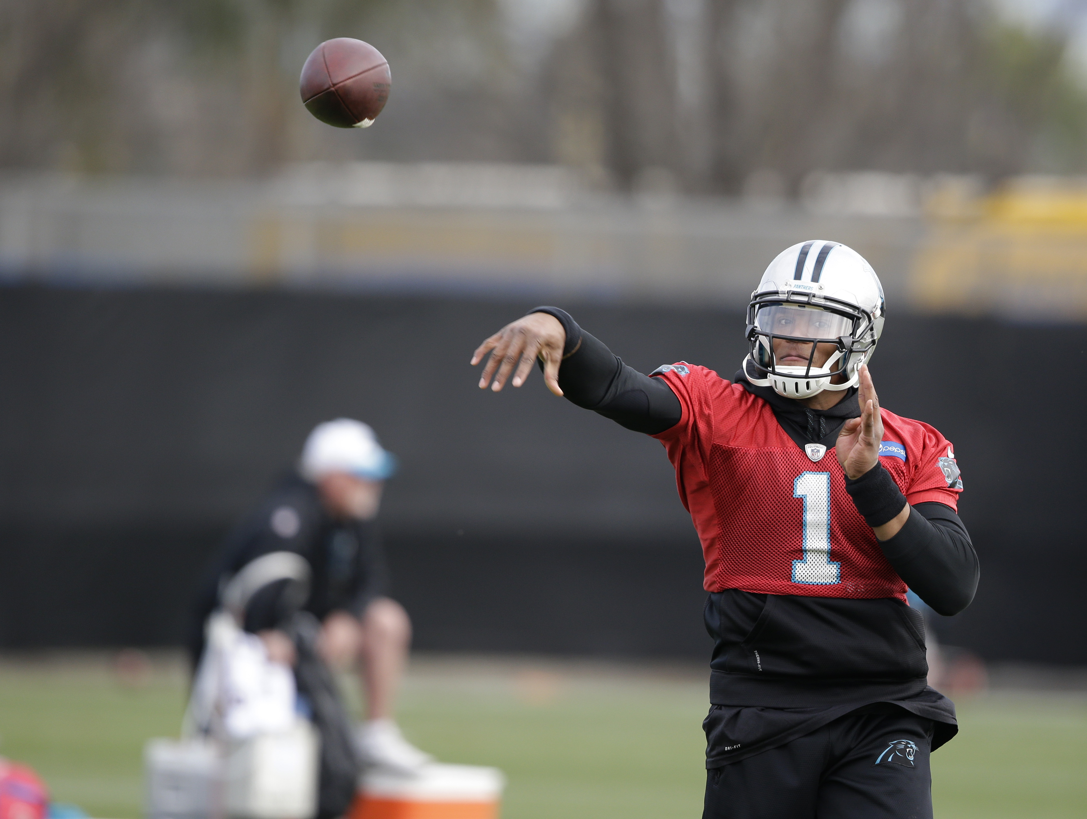 Carolina Panthers quarterback Cam Newton (1) throws during practice Wednesday, Feb. 3, 2016 in San Jose, Calif. Carolina plays the Denver Broncos in the NFL Super Bowl 50 football game Sunday, Feb. 7, 2015, in Santa Clara, Calif. (AP Photo/Marcio Jose San