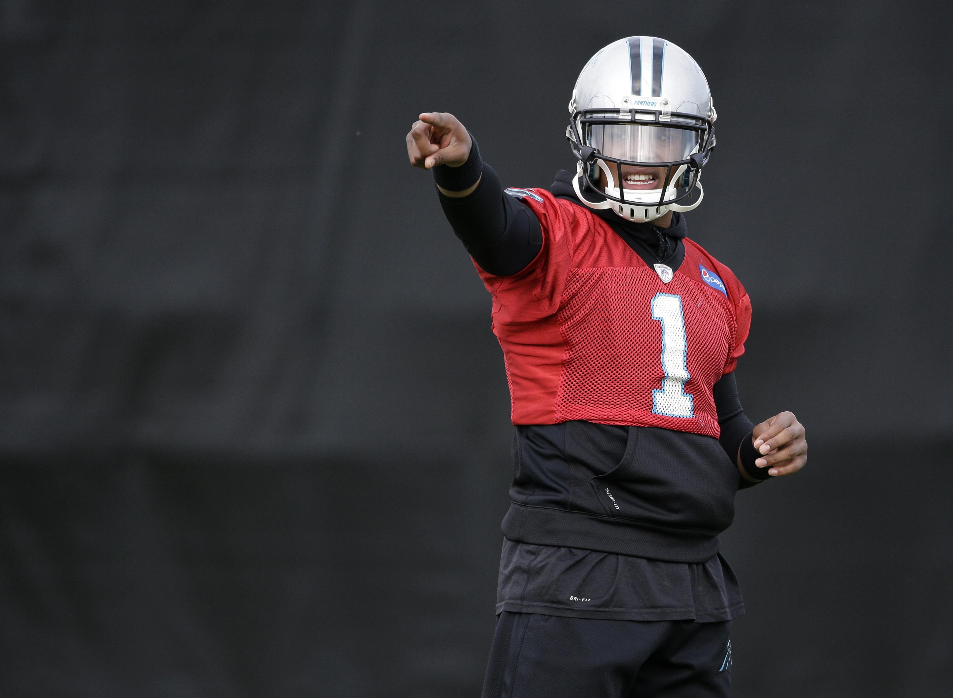 Carolina Panthers quarterback Cam Newton (1) directs receivers during practice Wednesday, Feb. 3, 2016 in San Jose, Calif. Carolina plays the Denver Broncos in the NFL Super Bowl 50 football game Sunday, Feb. 7, 2015, in Santa Clara, Calif. (AP Photo/Marc
