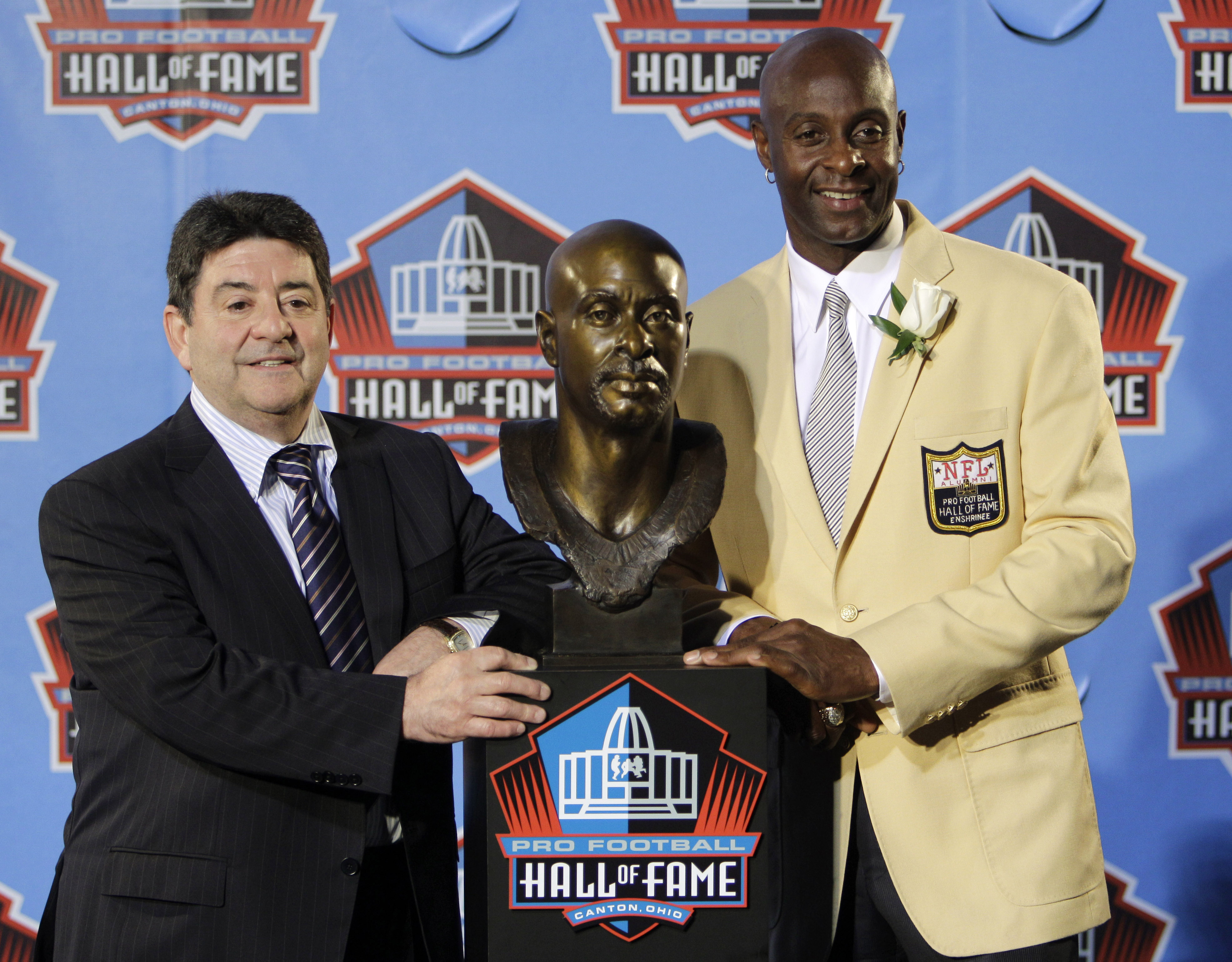 FILE - In this Aug. 7, 2010, file photo, former San Francisco 49ers great Jerry Rice, right, poses with former 49ers owner Edward DeBartolo Jr. after Rice's enshrinement in the Pro Football Hall of Fame in Canton, Ohio. DeBartolo played no favorites. When