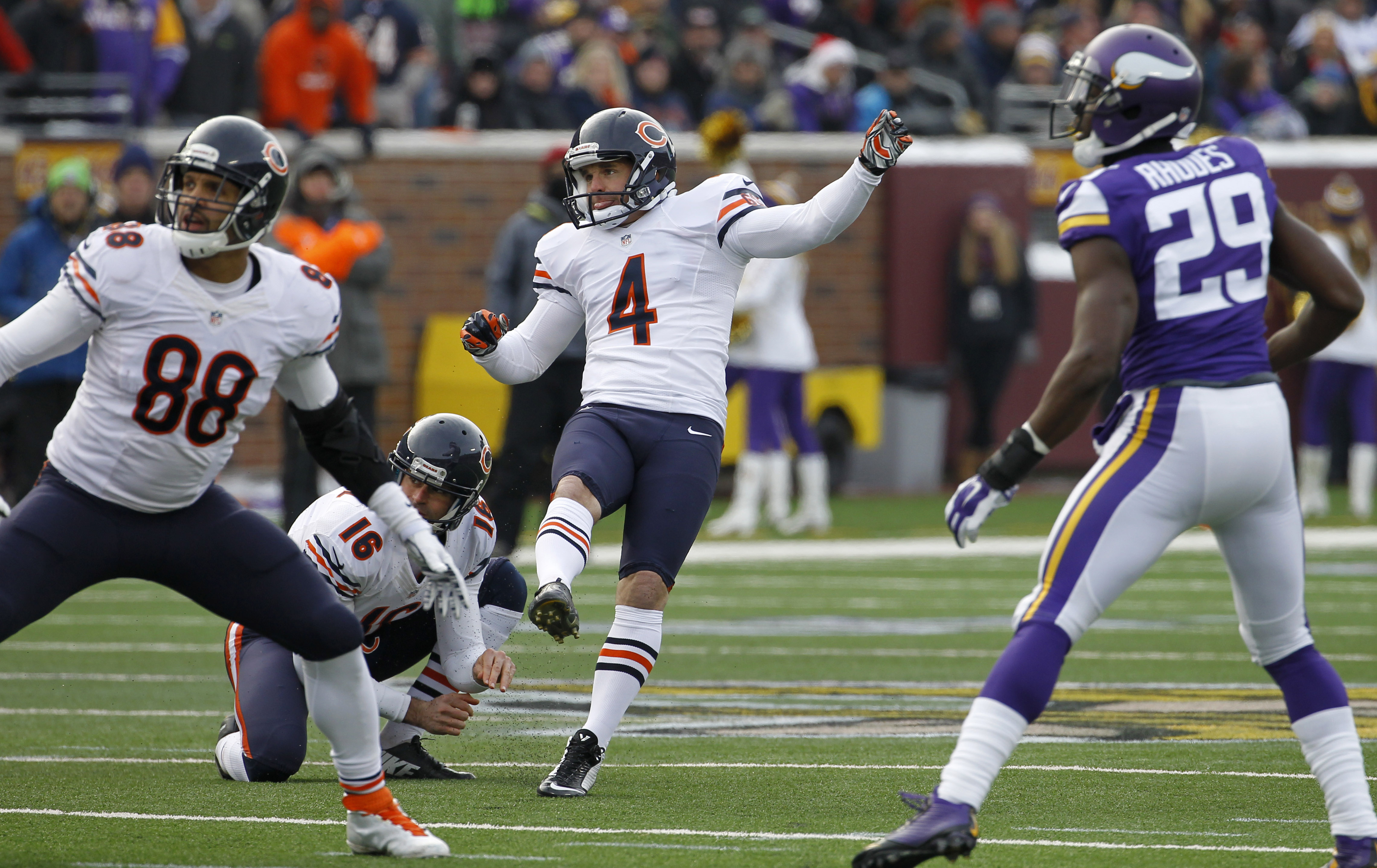 FILE - In this Dec. 28, 2014 file photo, Chicago Bears kicker Jay Feely (4) watches his 48-yard field goal during the first half of an NFL football game against the Minnesota Vikings, in Minneapolis. Feely has some conflicted emotions in his new role as C