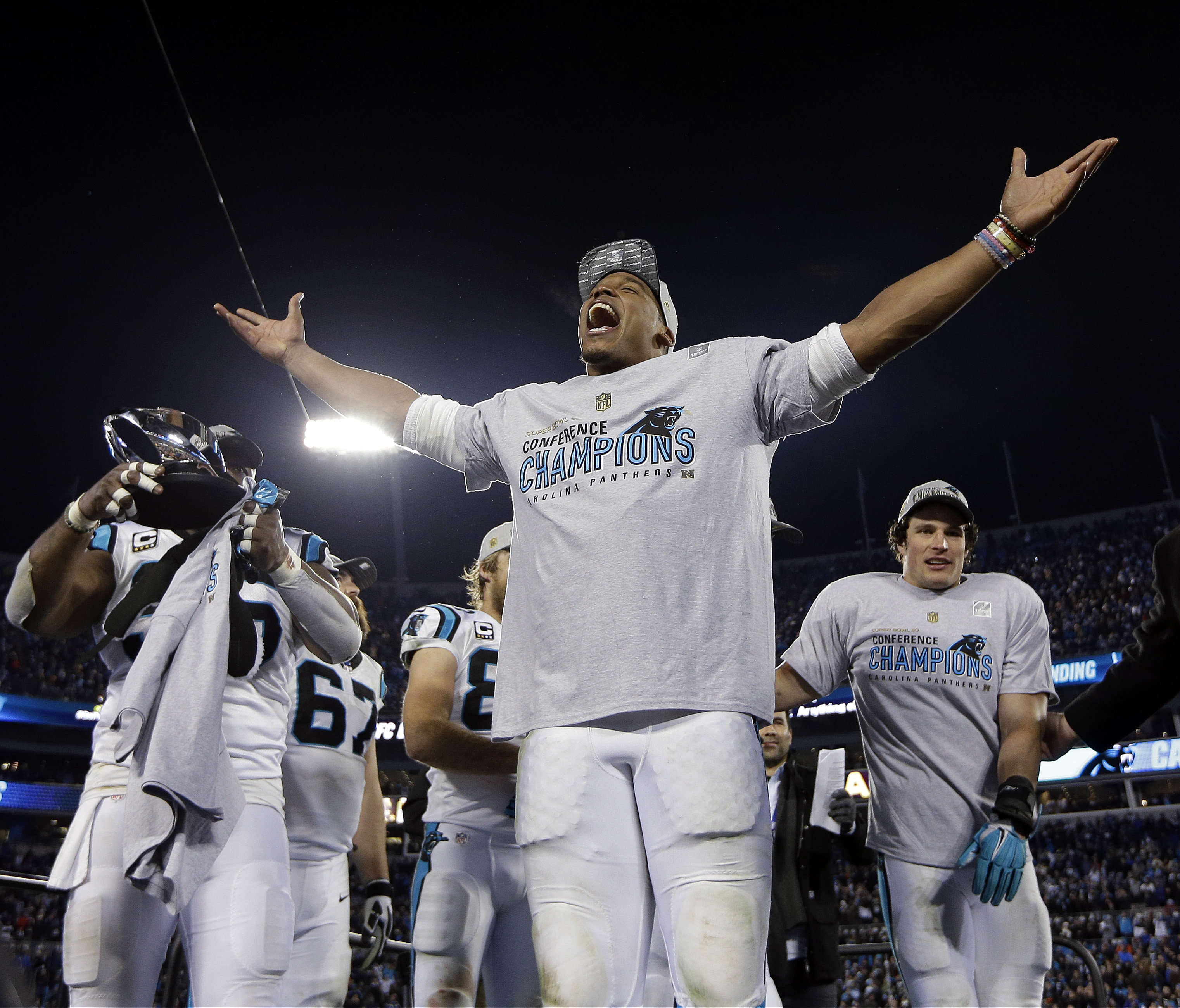 FILE - In this Jan. 24, 2016 file photo, Carolina Panthers' Cam Newton celebrates after the NFL football NFC Championship game against the Arizona Cardinals in Charlotte, N.C. Newton is wearing Lokai silicone bead bracelets with a bit of water from Mount