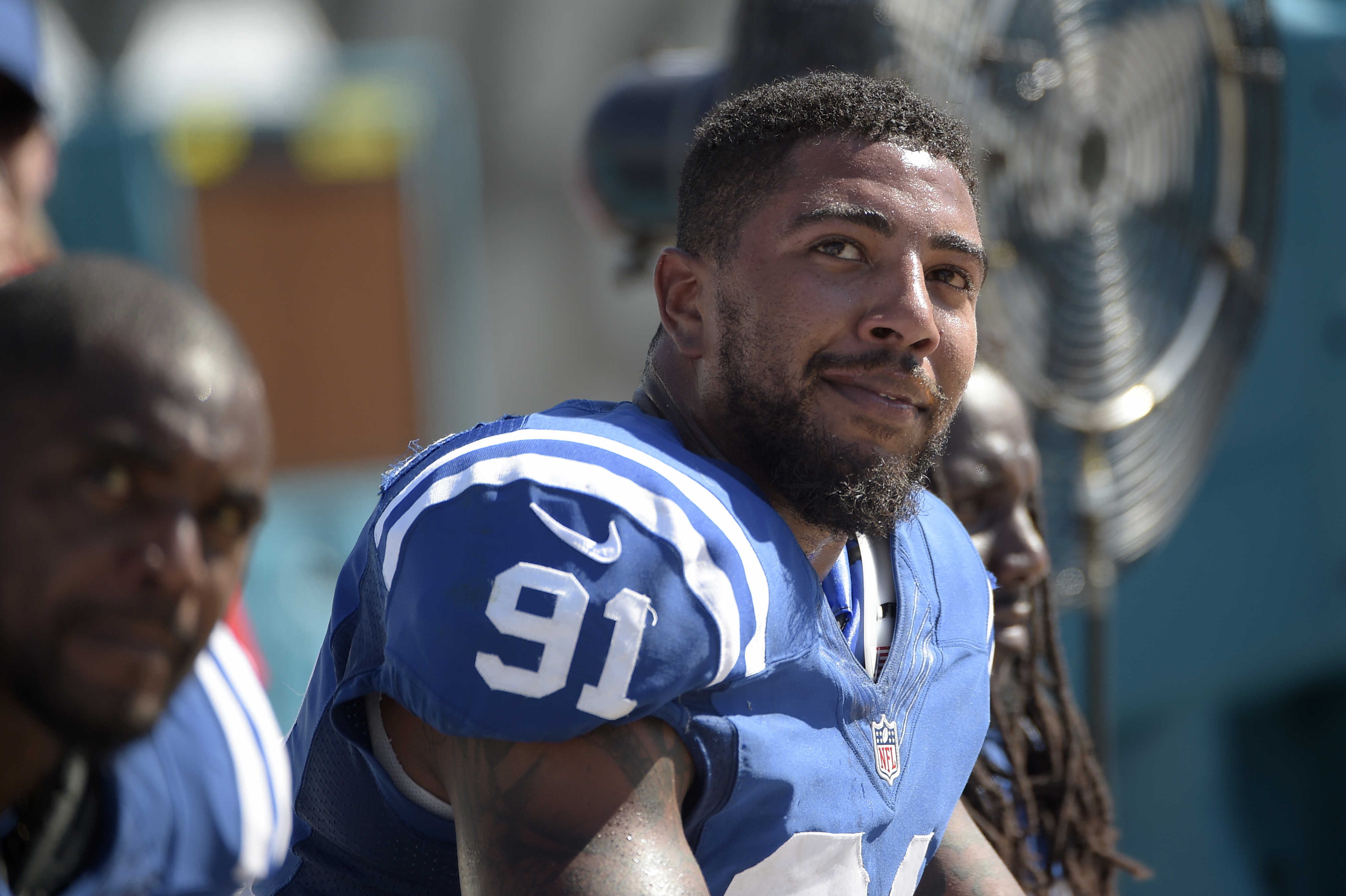 Indianapolis Colts linebacker Jonathan Newsome (91) and running back Ahmad Bradshaw, left, watch from the bench during the second half of an NFL football game against the Jacksonville Jaguars in Jacksonville, Fla., Sunday, Sept. 21, 2014.(AP Photo/Phelan