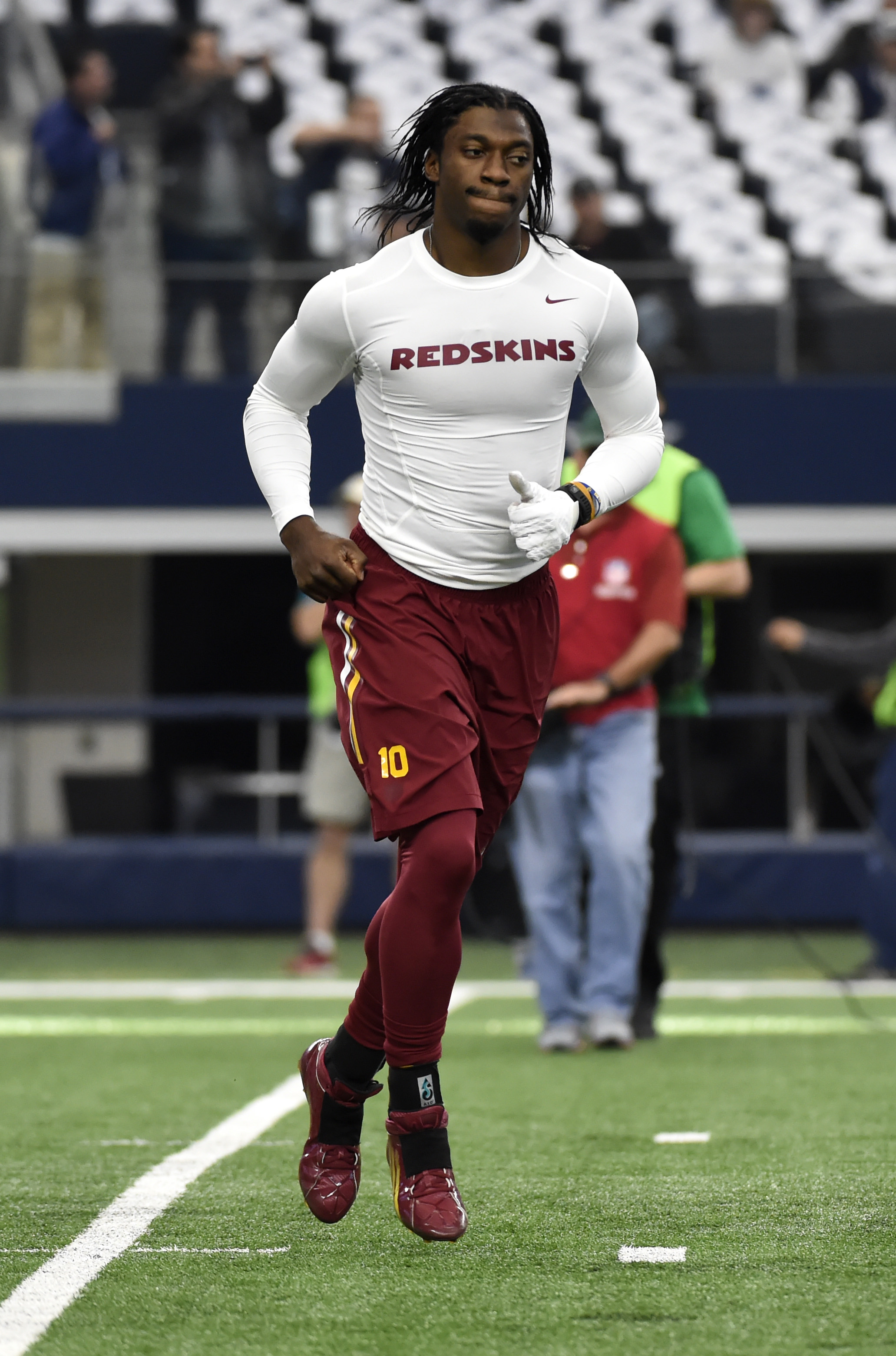 Washington Redskins' Robert Griffin III jogs off the field during warm ups before an NFL football game against the Dallas Cowboys, Sunday, Jan. 3, 2016, in Arlington , Texas. (AP Photo/Michael Ainsworth)