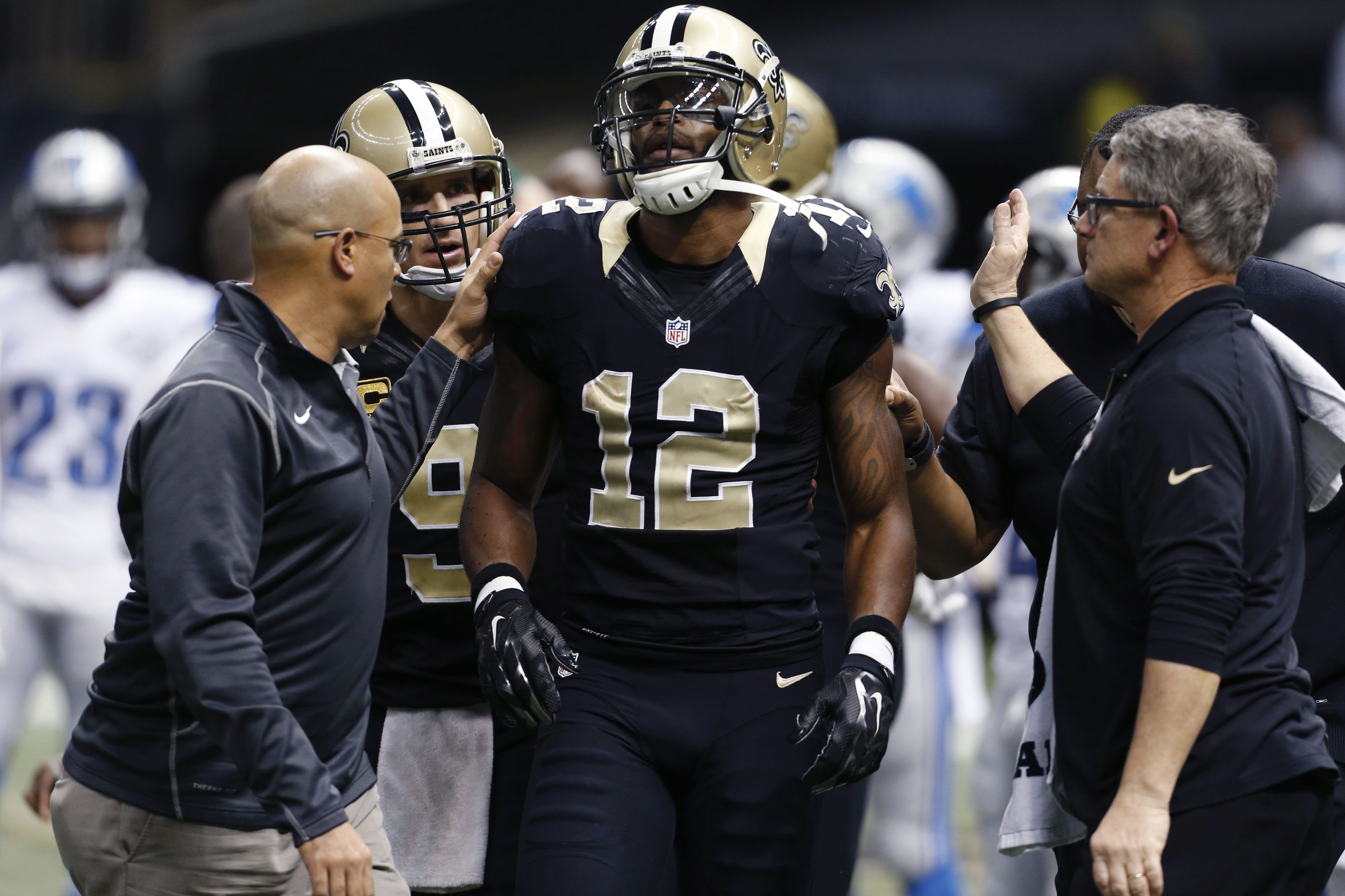 New Orleans Saints wide receiver Marques Colston (12) is tended to after he was hit by Detroit Lions strong safety Isa Abdul-Quddus in the second half of an NFL football game in New Orleans, Monday, Dec. 21, 2015. Abdul-Quddus was penalized for a helmet-t