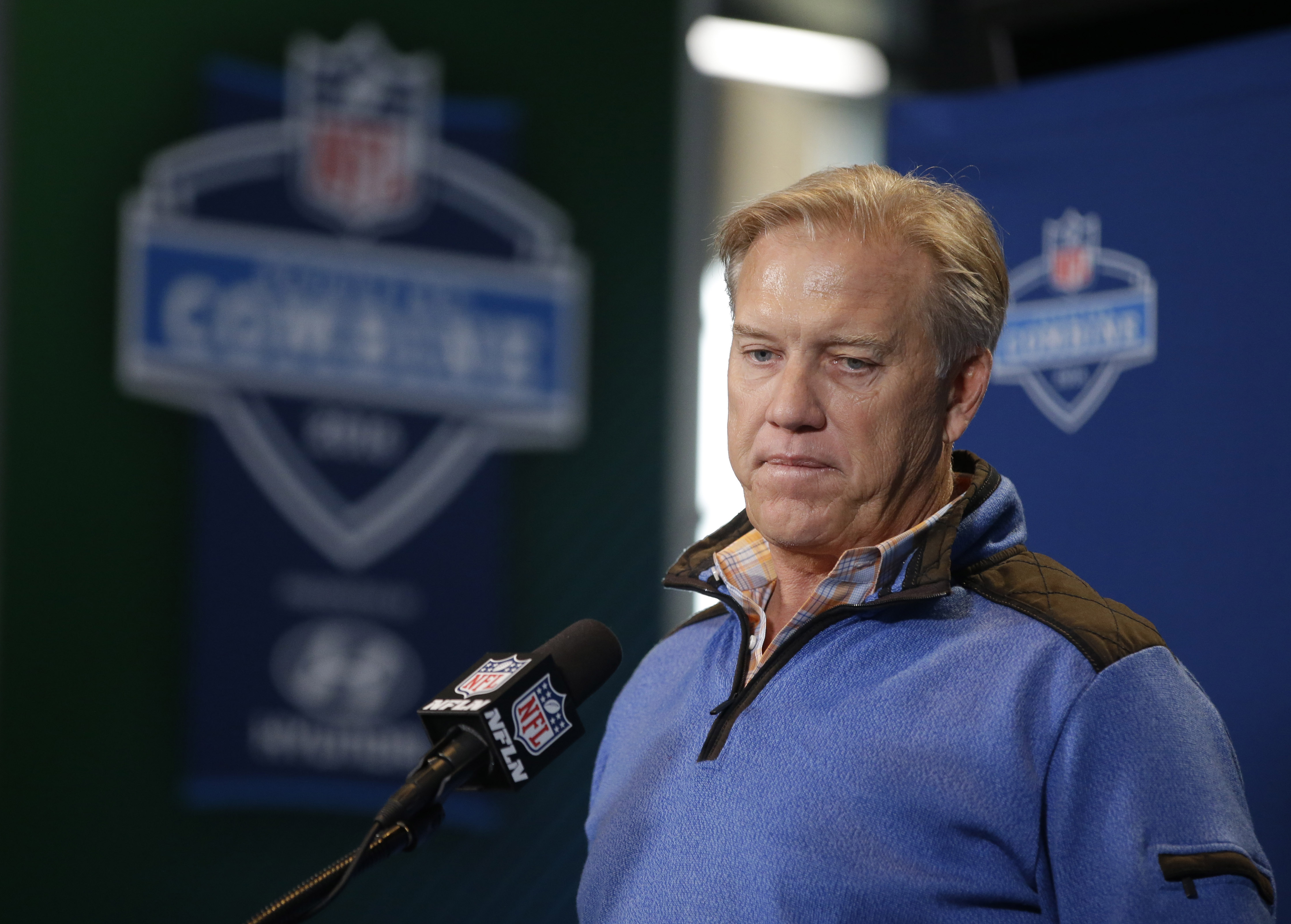 Denver Broncos general manager John Elway listens to a question during a news conference at the NFL football scouting combine Thursday, Feb. 25, 2016, in Indianapolis. (AP Photo/Darron Cummings)