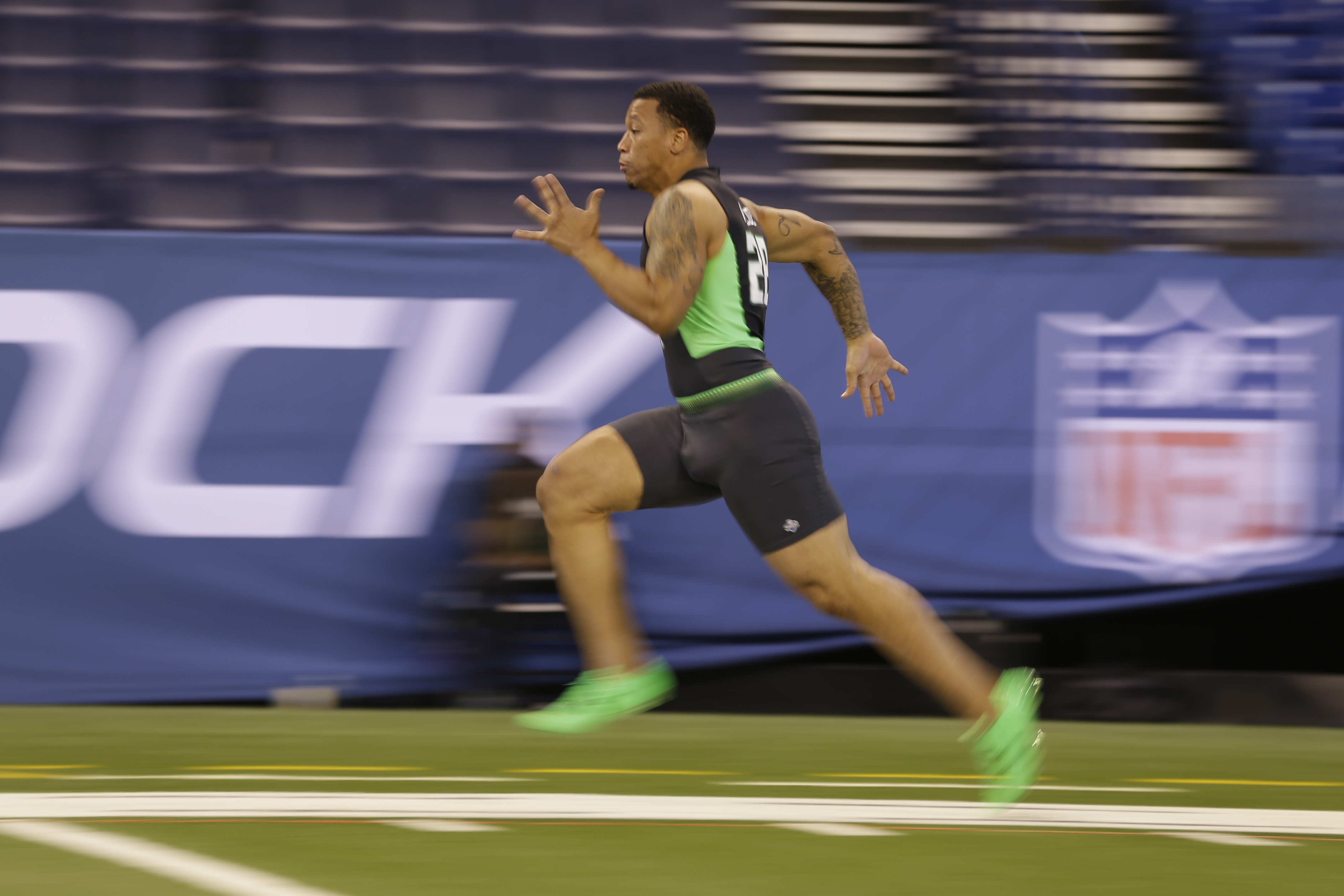 In this image taken with a slow shutter speed, South Carolina running back Brandon Wilds runs the 40-yard dash at the NFL football scouting combine in Indianapolis, Friday, Feb. 26, 2016. (AP Photo/Michael Conroy)