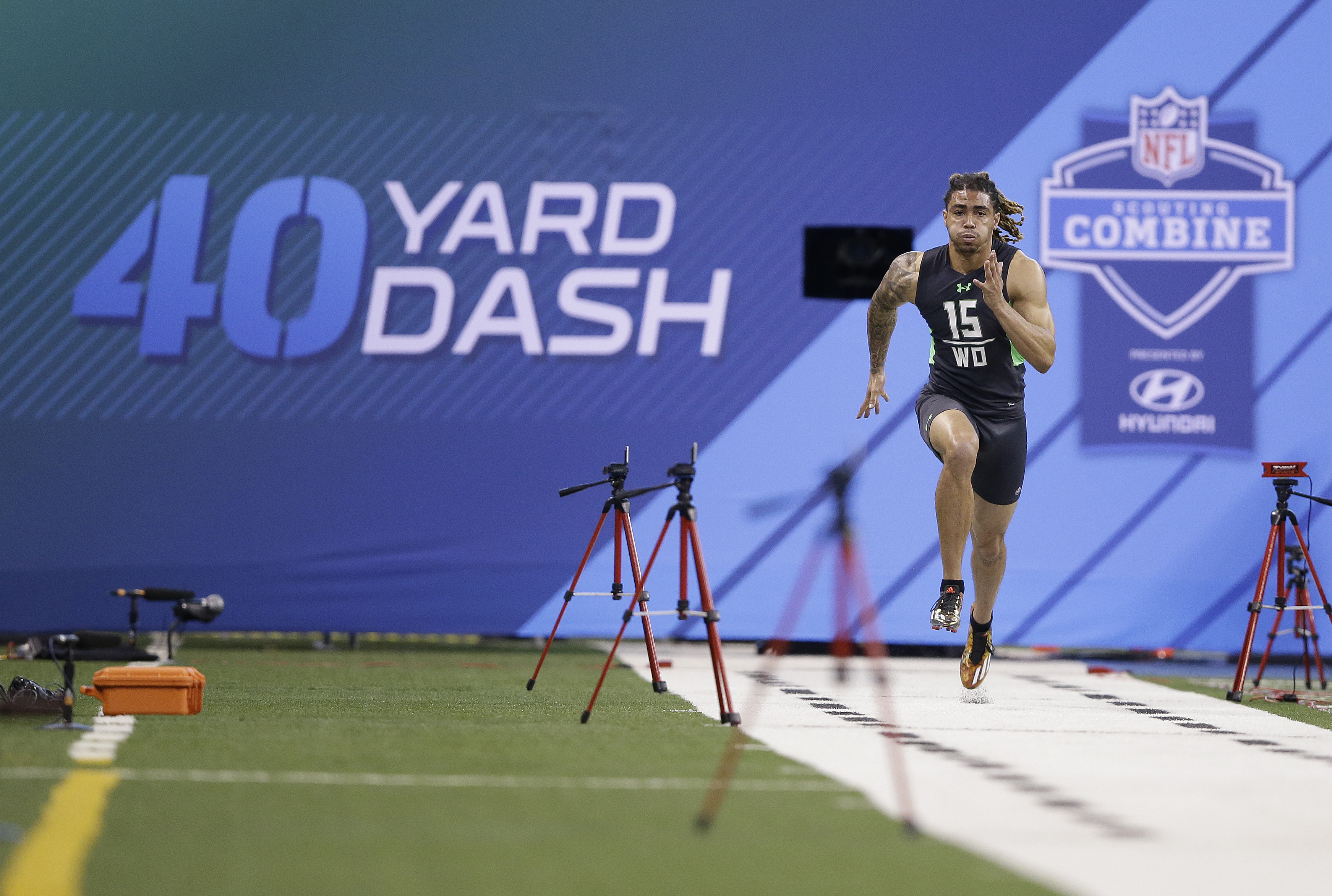 Notre Dame receiver Will Fuller runs the 40-yard dash at the NFL football scouting combine in Saturday, Feb. 27, 2016, in Indianapolis. (AP Photo/Darron Cummings)