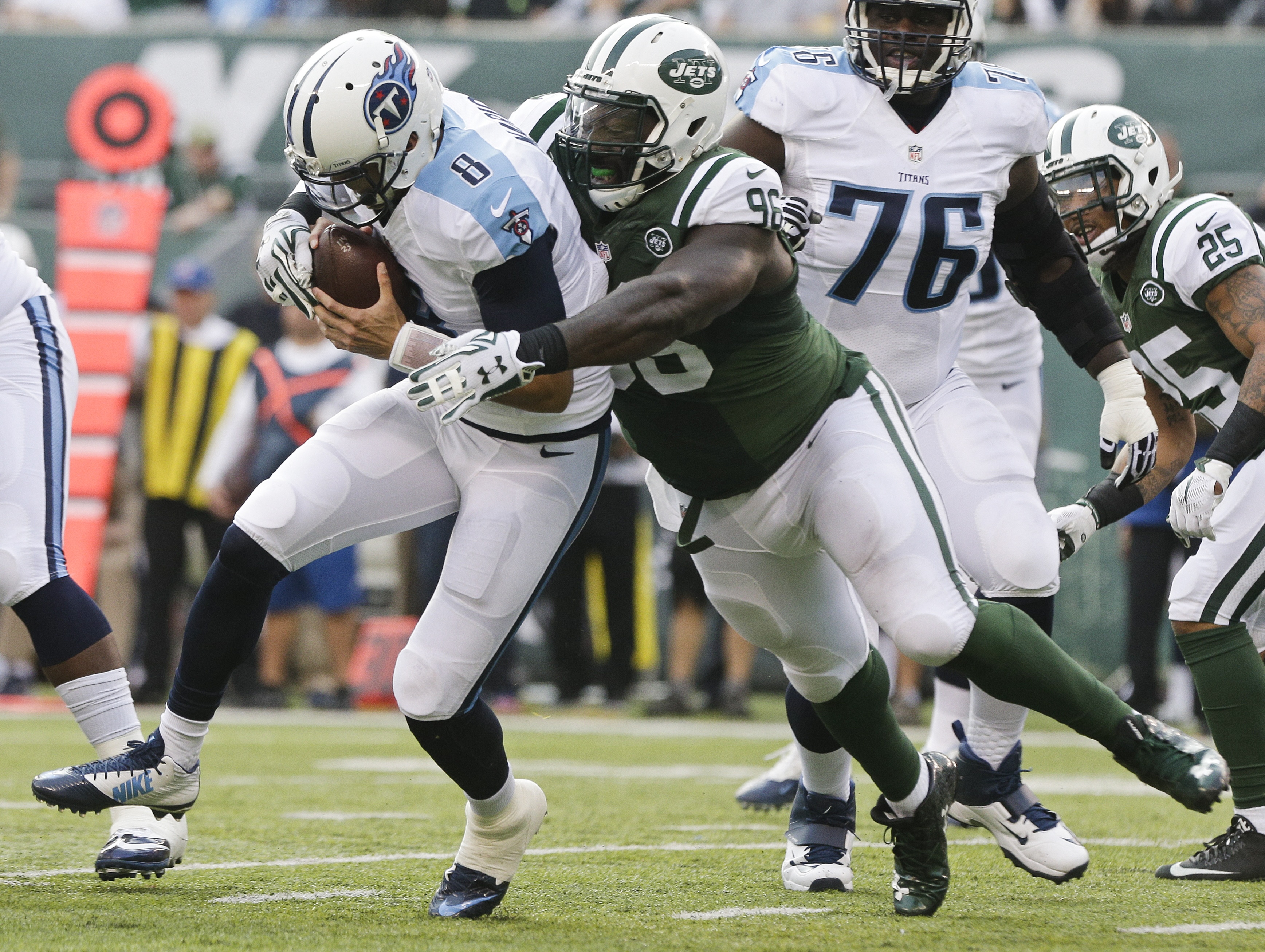 FILe - In this Dec. 13, 2015, file photo, New York Jets defensive end Muhammad Wilkerson (96) sacks Tennessee Titans quarterback Marcus Mariota (8) during the first half of an NFL football game, in East Rutherford, N.J. A person with knowledge of the team