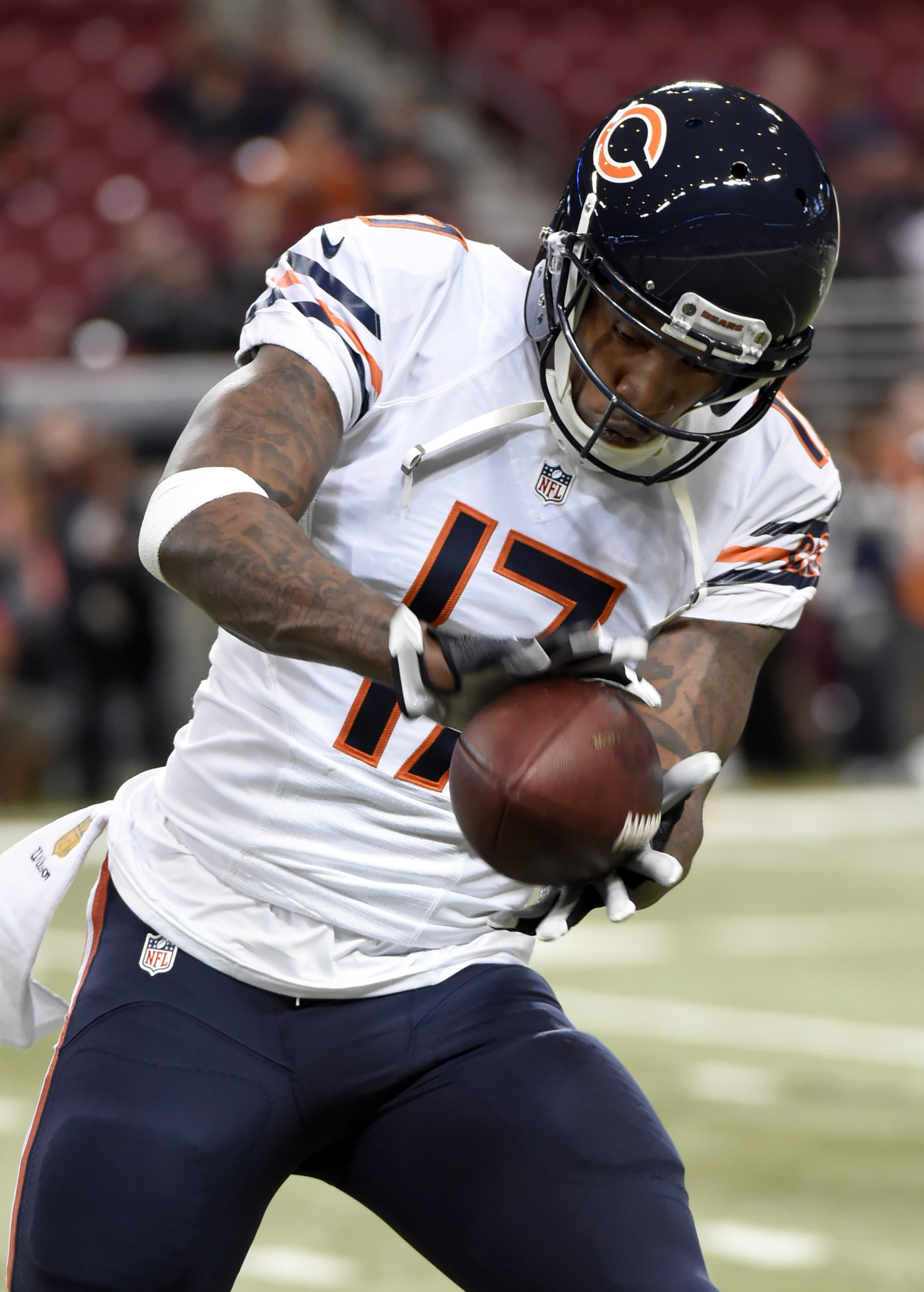 In this Sunday, Nov. 15, 2015 photo, Chicago Bears wide receiver Alshon Jeffery warms up before the start of their NFL football game with the St. Louis Rams in St. Louis. The Bears have placed the franchise tag on top receiver Jeffery. With the move annou