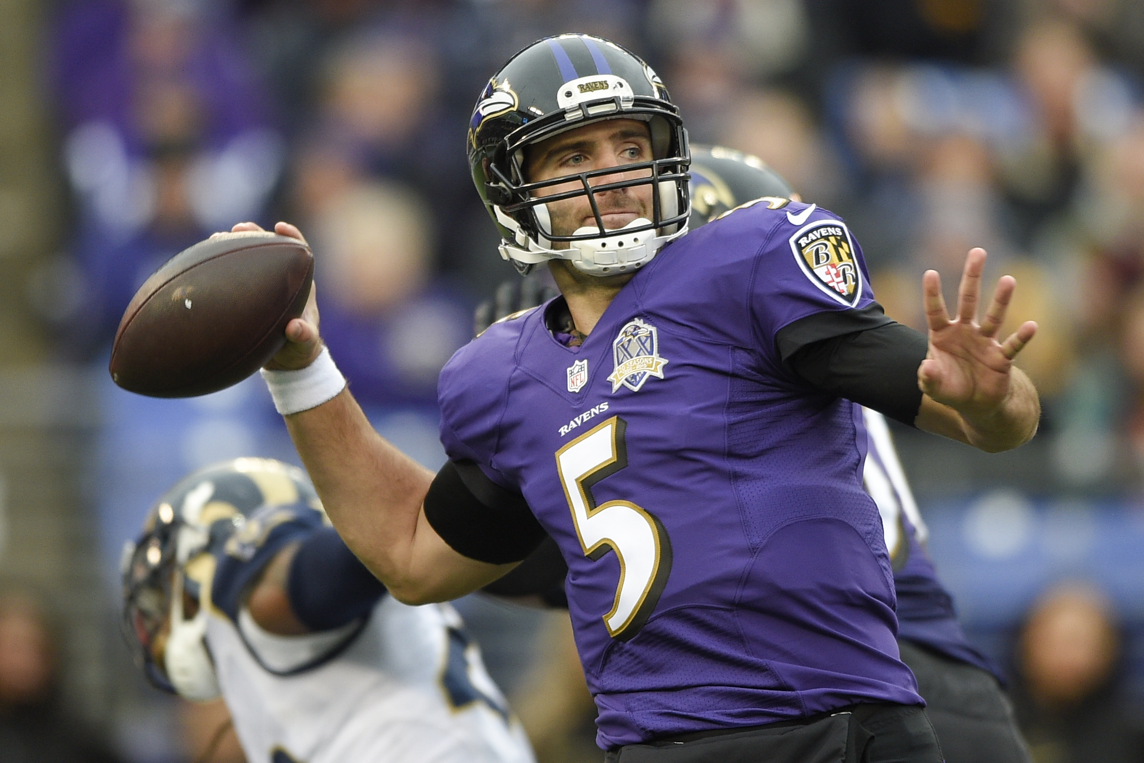 Baltimore Ravens quarterback Joe Flacco (5) passes the ball during the second half of an NFL football game against the St. Louis Rams in Baltimore, Sunday, Nov. 22, 2015. (AP Photo/Nick Wass)