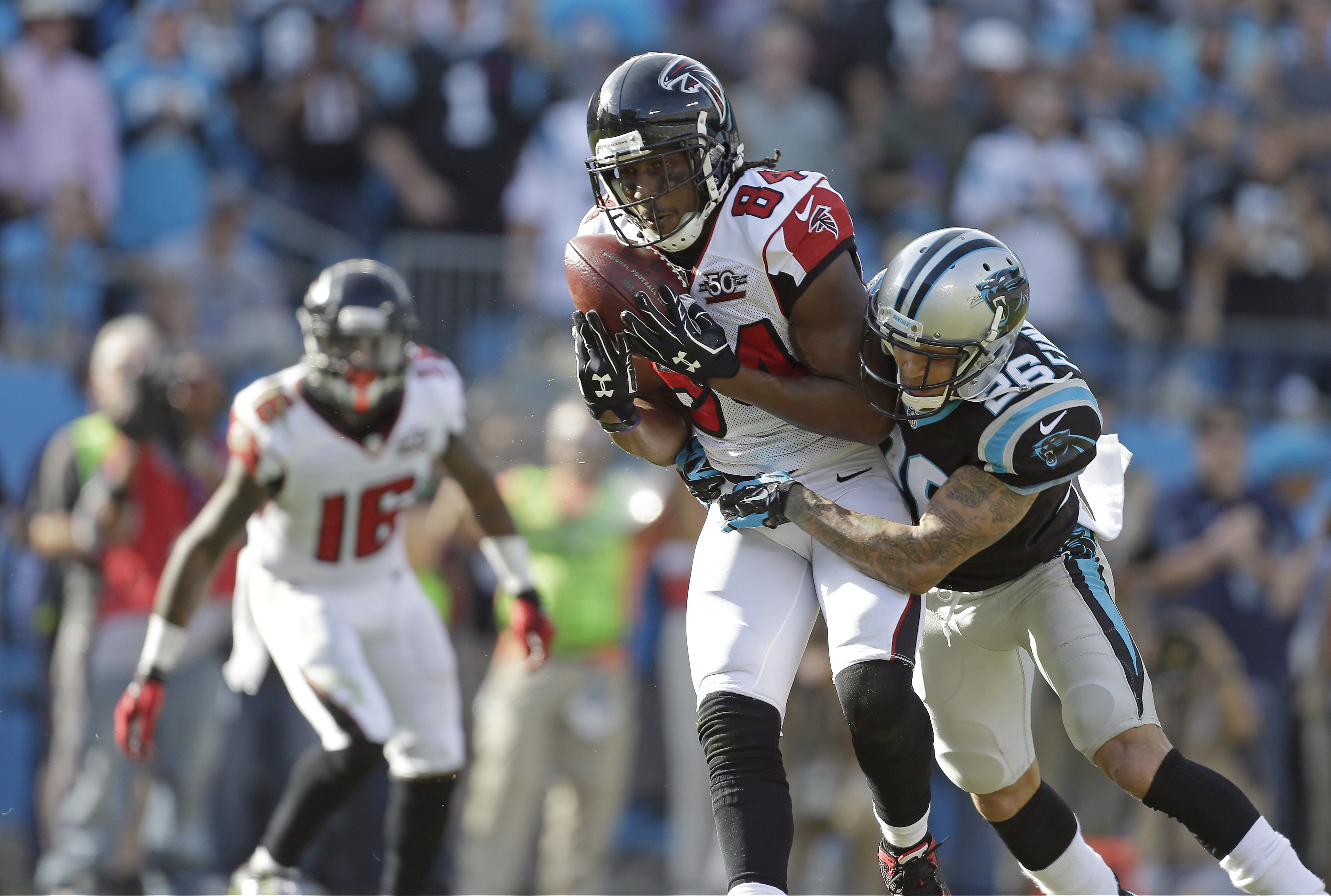 FILE - In this  Sunday, Dec. 13, 2015 file photo, Atlanta Falcons' Roddy White (84) makes a catch as Carolina Panthers' Cortland Finnegan (26) makes the hit during the first half of an NFL football game in Charlotte, N.C.  The Atlanta Falcons have release