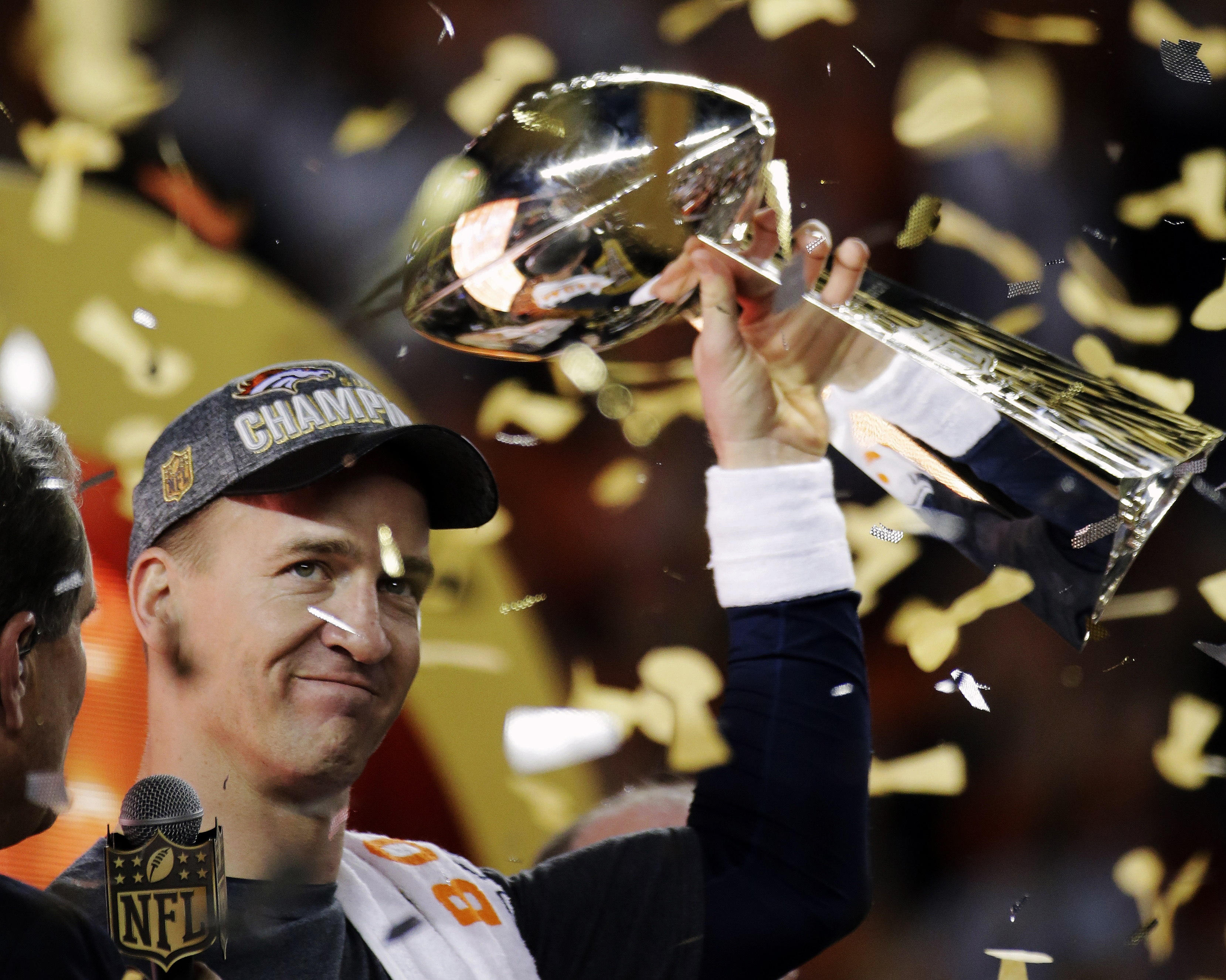FILE - In this Feb. 7, 2016, file photo, Denver Broncos' Peyton Manning holds up the trophy after the NFL Super Bowl 50 football game in Santa Clara, Calif. A person with knowledge of the decision tells The Associated Press on Sunday, March 6, 2016, that