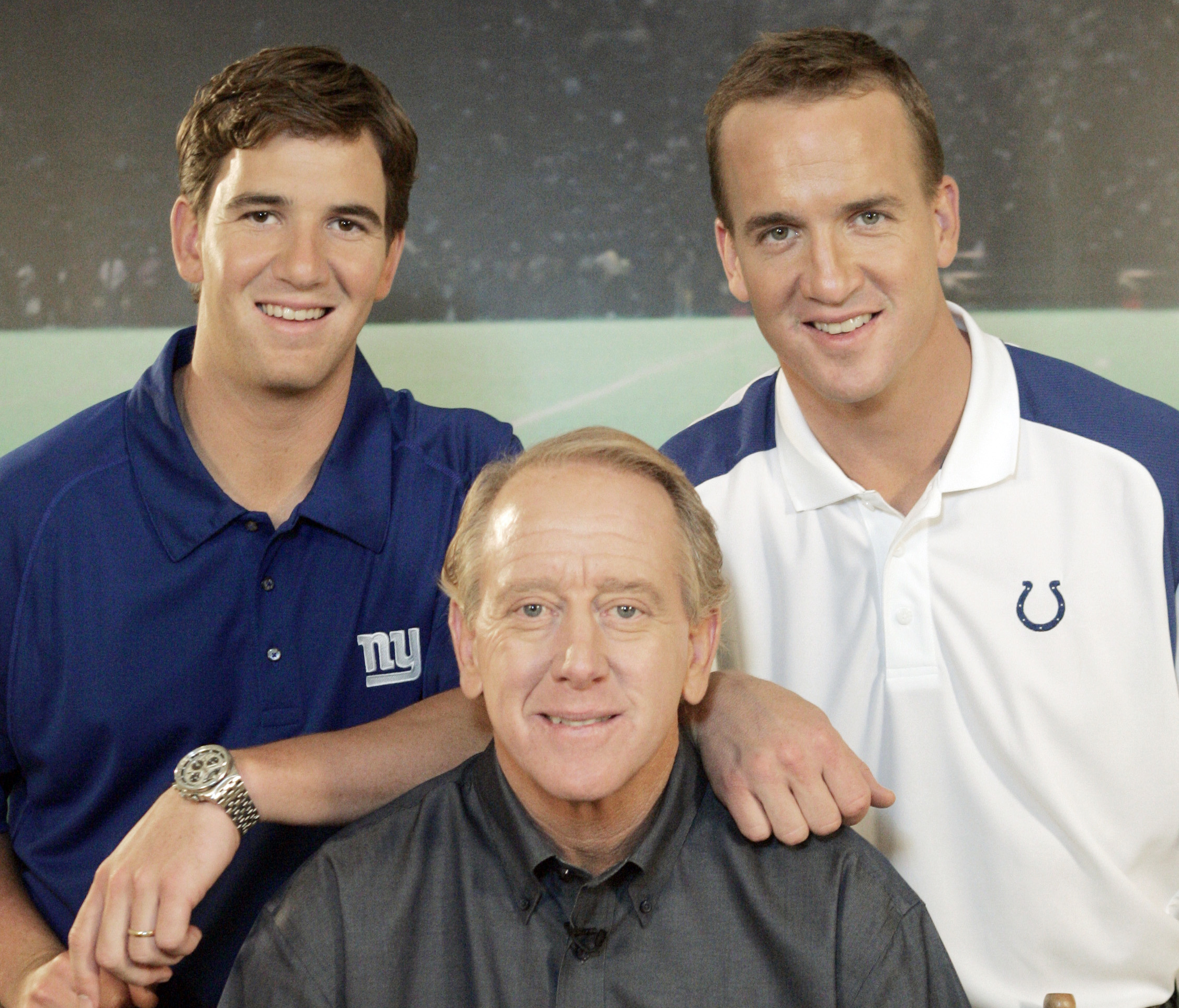FILE - In this May 8, 2008, file photo, Archie Manning, center, is joined by his sons Eli Manning, left, and Peyton Manning, in Beverly Hills, Calif. A person with knowledge of the decision tells The Associated Press on Monday, March 6, 2016, that Peyton