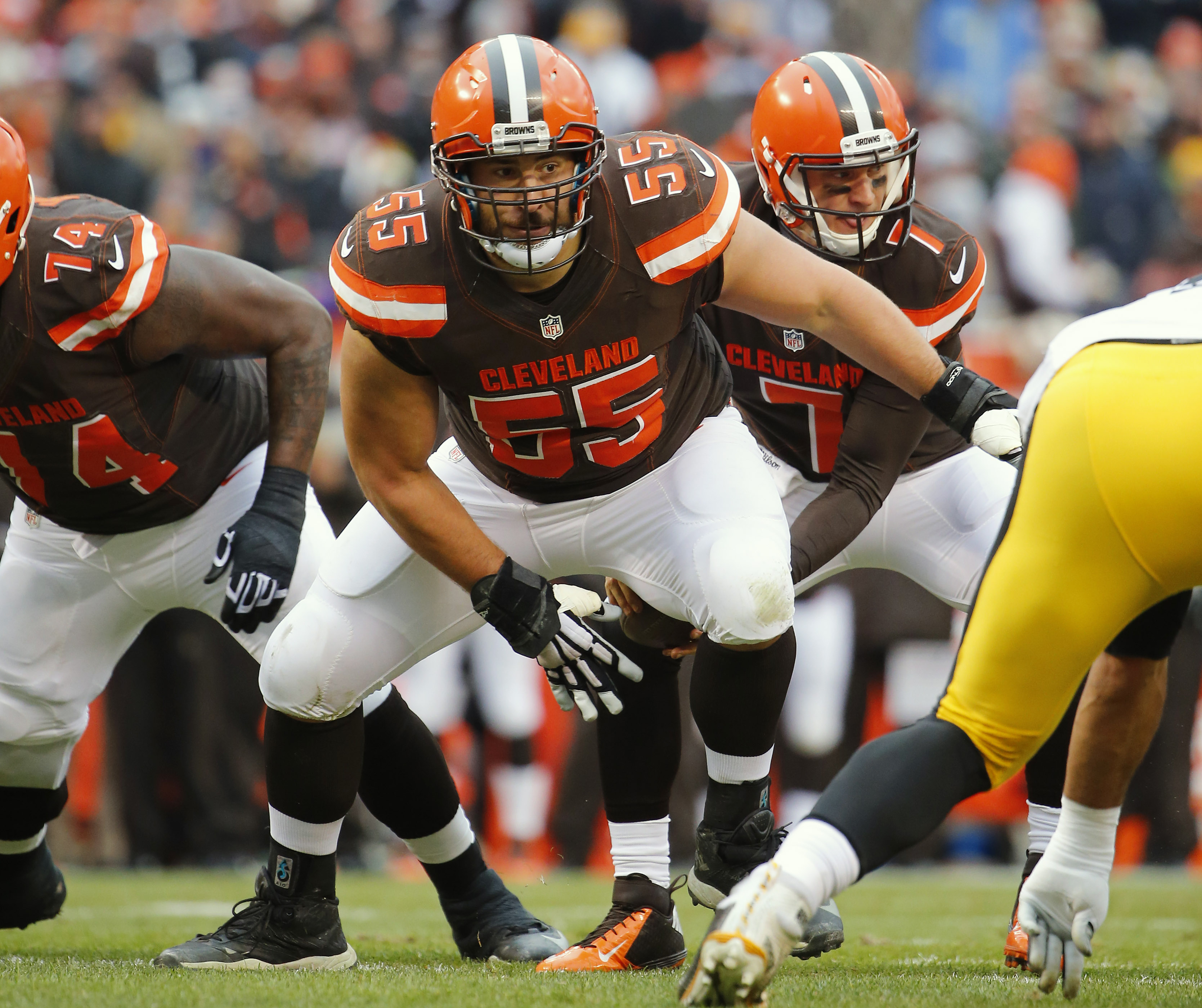FILE - In this Jan. 3, 2016, file photo, Cleveland Browns center Alex Mack is shown during an NFL football game against the Pittsburgh Steelers in Cleveland. While the draft often comes down to who is the highest-rated player overall when a team's turn co