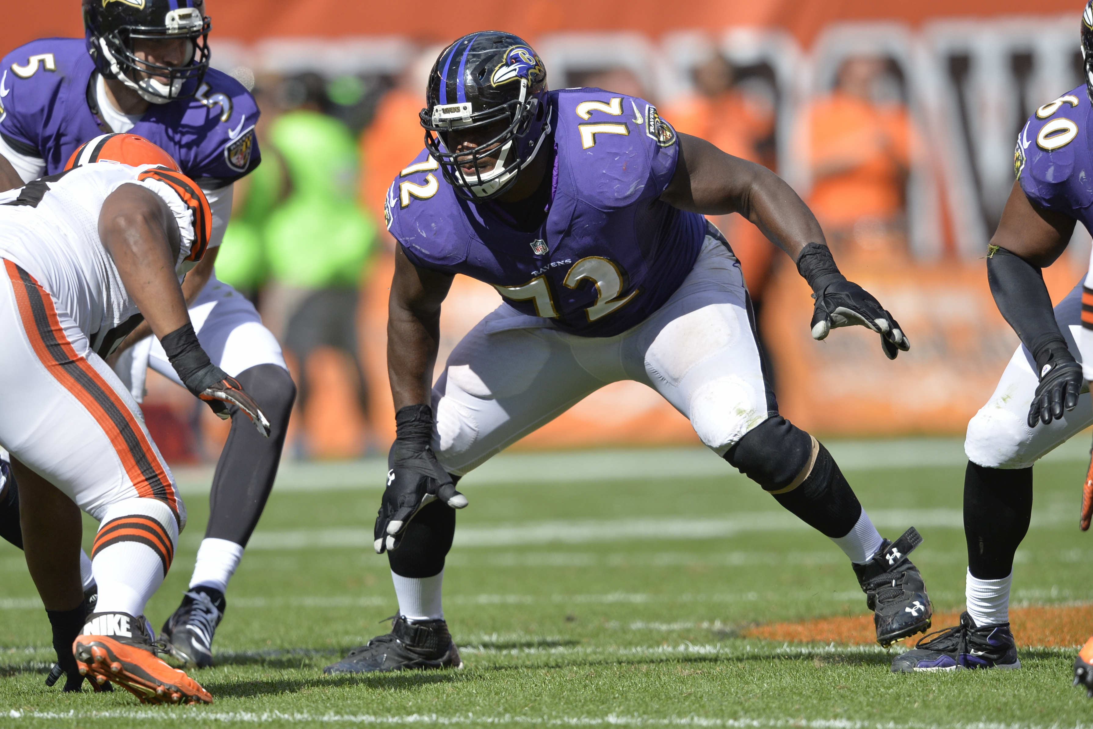 FILE - In this Sept. 21, 2014, file photo, Baltimore Ravens guard Kelechi Osemele (72) blocks during an NFL football game against the Cleveland Brown, in Cleveland. While the draft often comes down to who is the highest-rated player overall when a team's