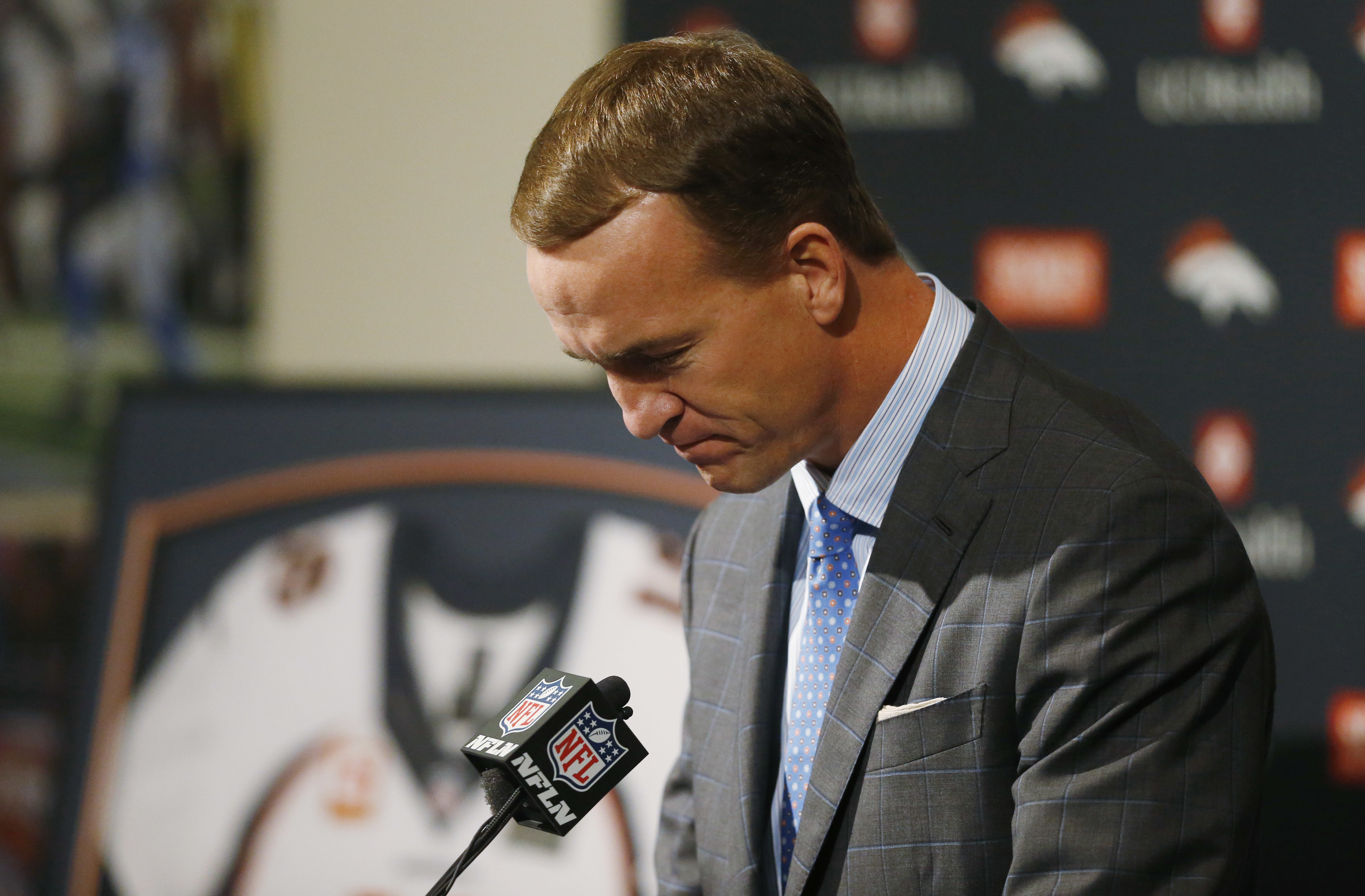 Denver Broncos quarterback Peyton Manning struggles to talk during his retirement announcement at team headquarters Monday, March 7, 2016, in Englewood, Colo. Manning, who has been in the NFL for the past 18 years, is retiring after winning five MVP troph